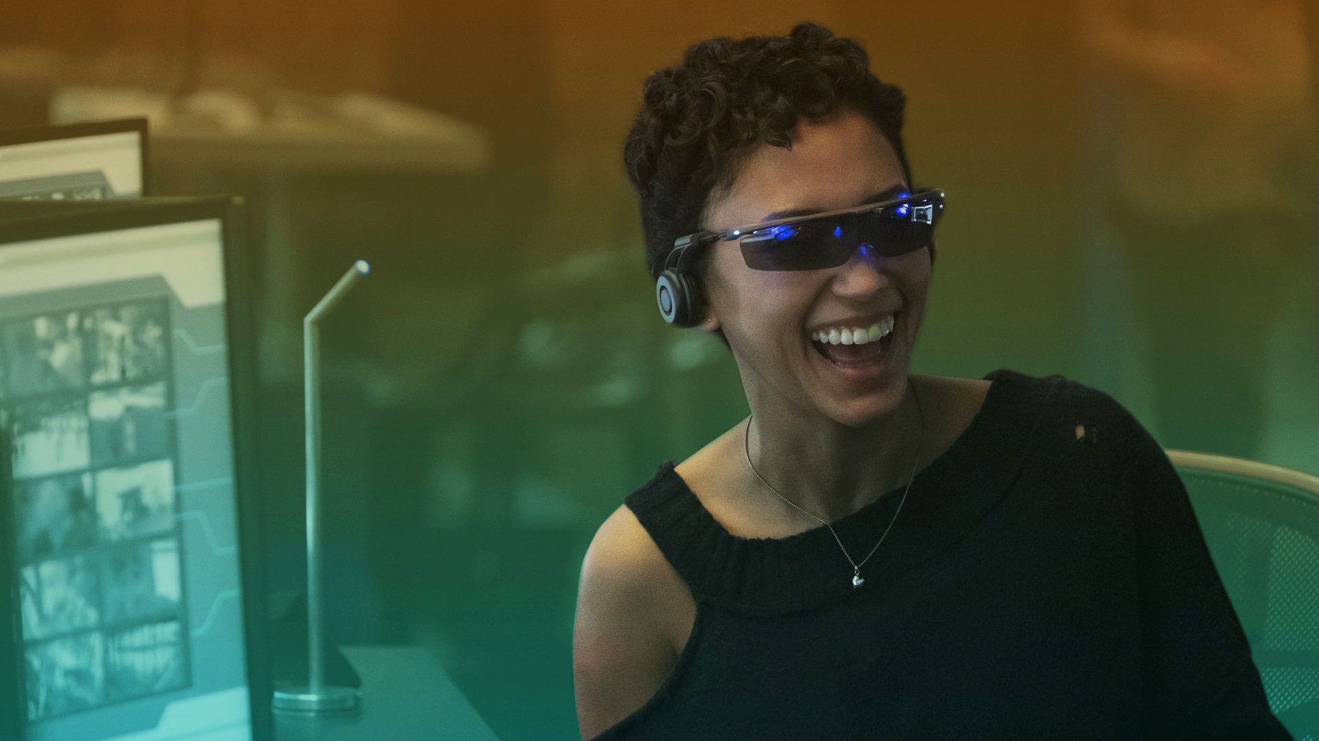 woman wearing sunglasses and headphones laughing