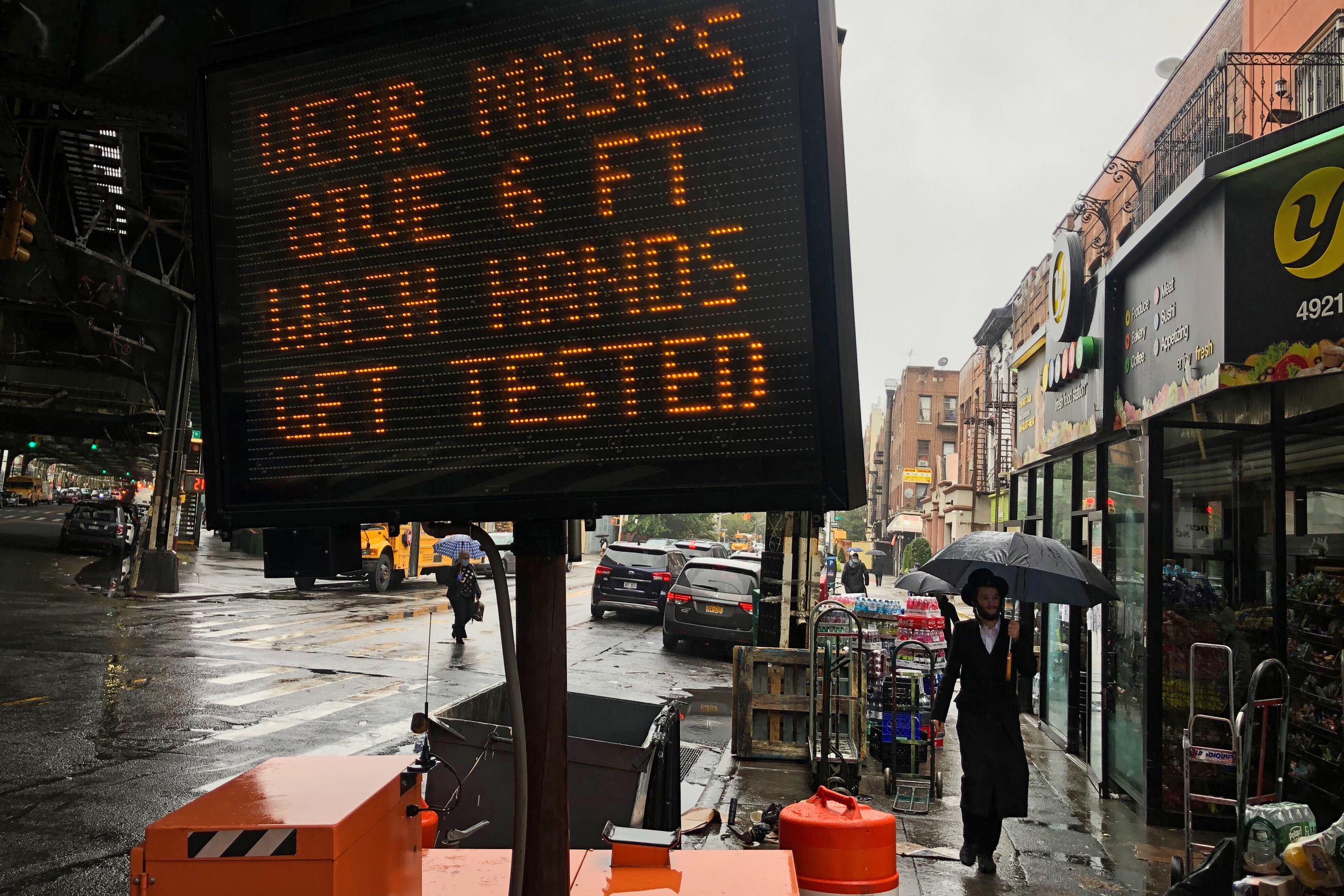 The city placed a sign in Borough Park, Brooklyn imploring residents to follow safety guidelines during the coronavirus outbreak, Oct. 13, 2020.