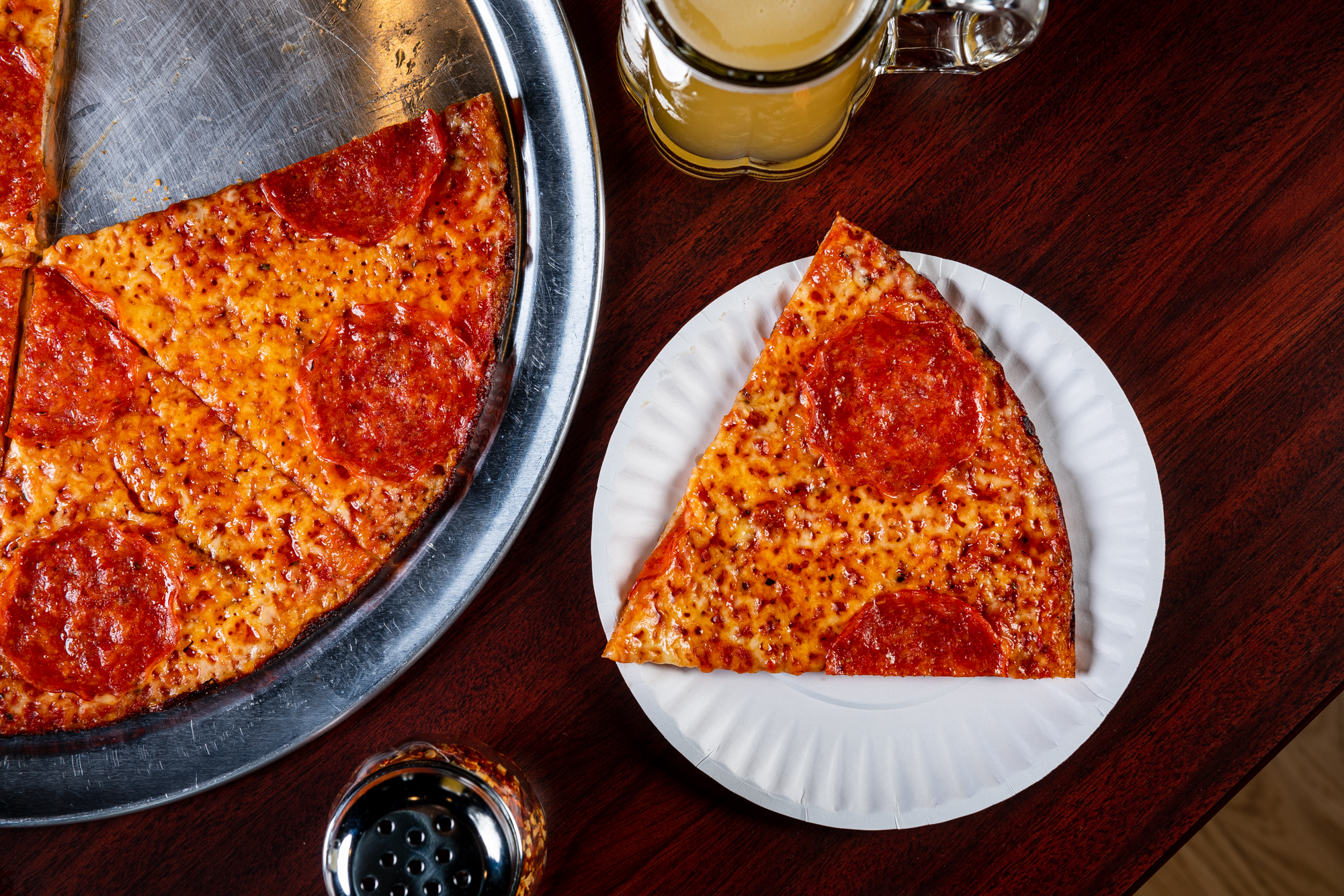 Wide, thin slices of pepperoni are one of 12 topping options at Colony Grill.