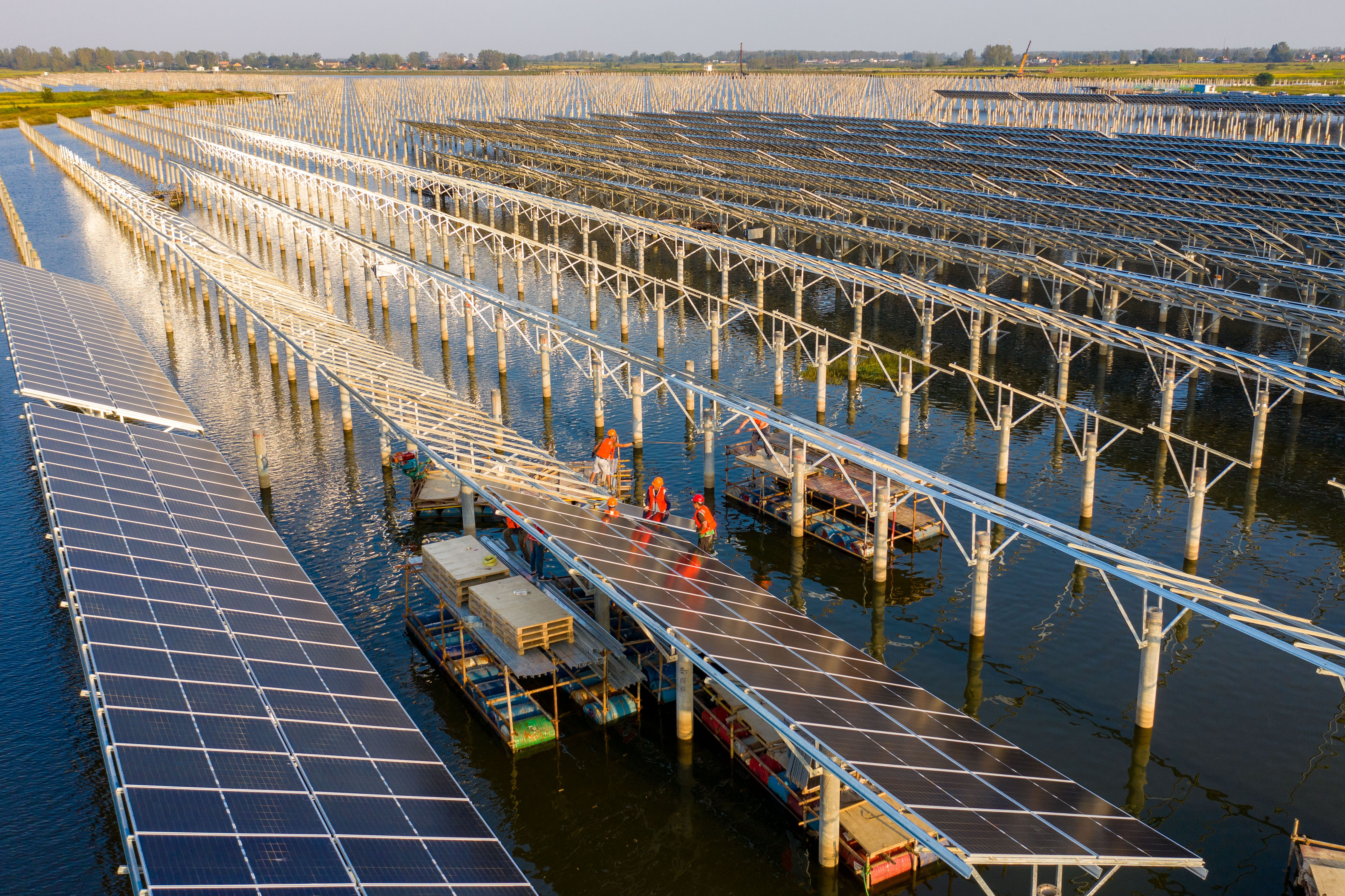 Image of solar photovoltaic power station on a lake.