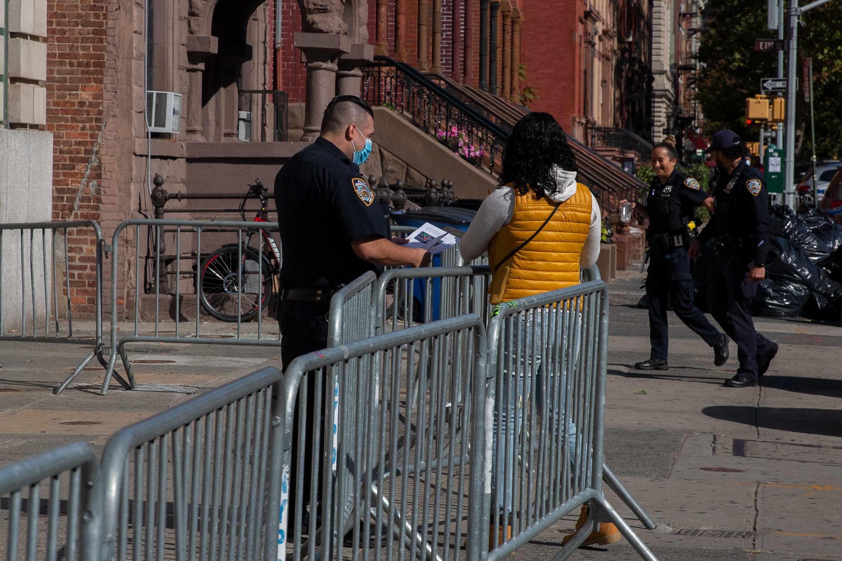 An NYPD officer speaks with a woman outside the 40th Precinct in the South Bronx, Oct. 15, 2020.