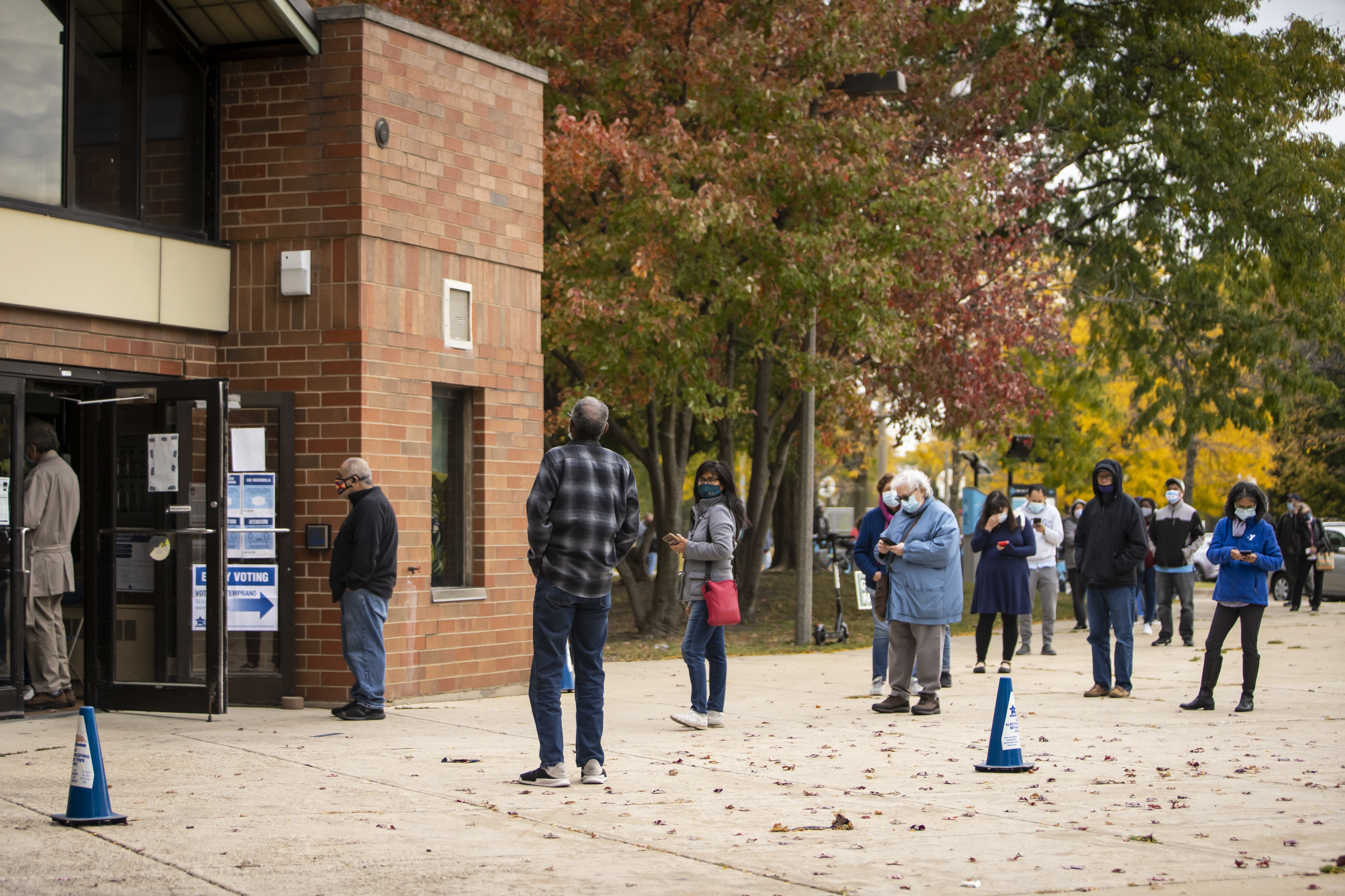 Dozens wait in line to early vote at Warren Park in the West Rogers Park neighborhood Wednesday morning.
