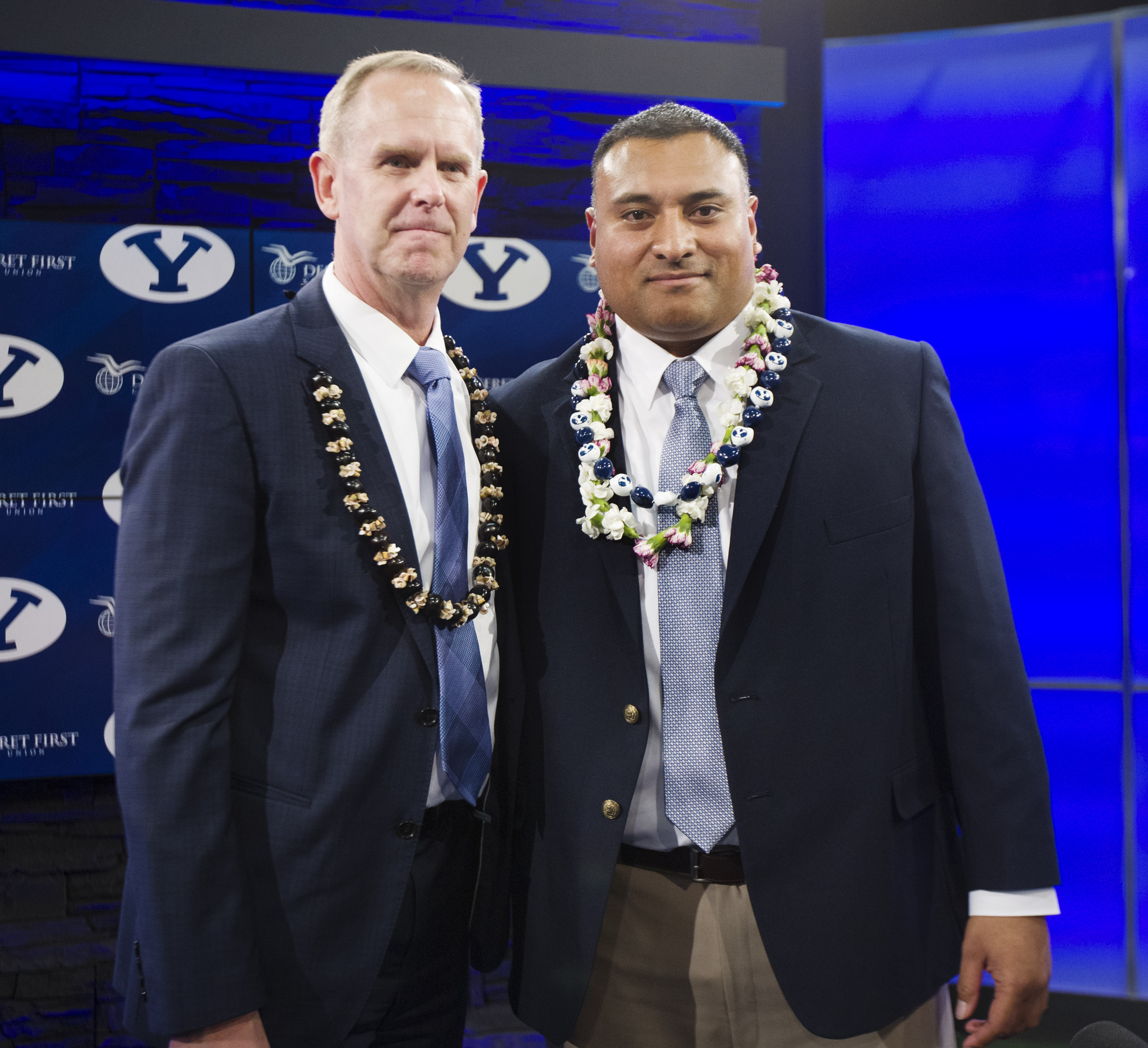 BYU athletic director Tom Holmoe, left, poses with new head football coach Kalani Sitake following a press conference in Provo Monday, Dec. 21, 2015.