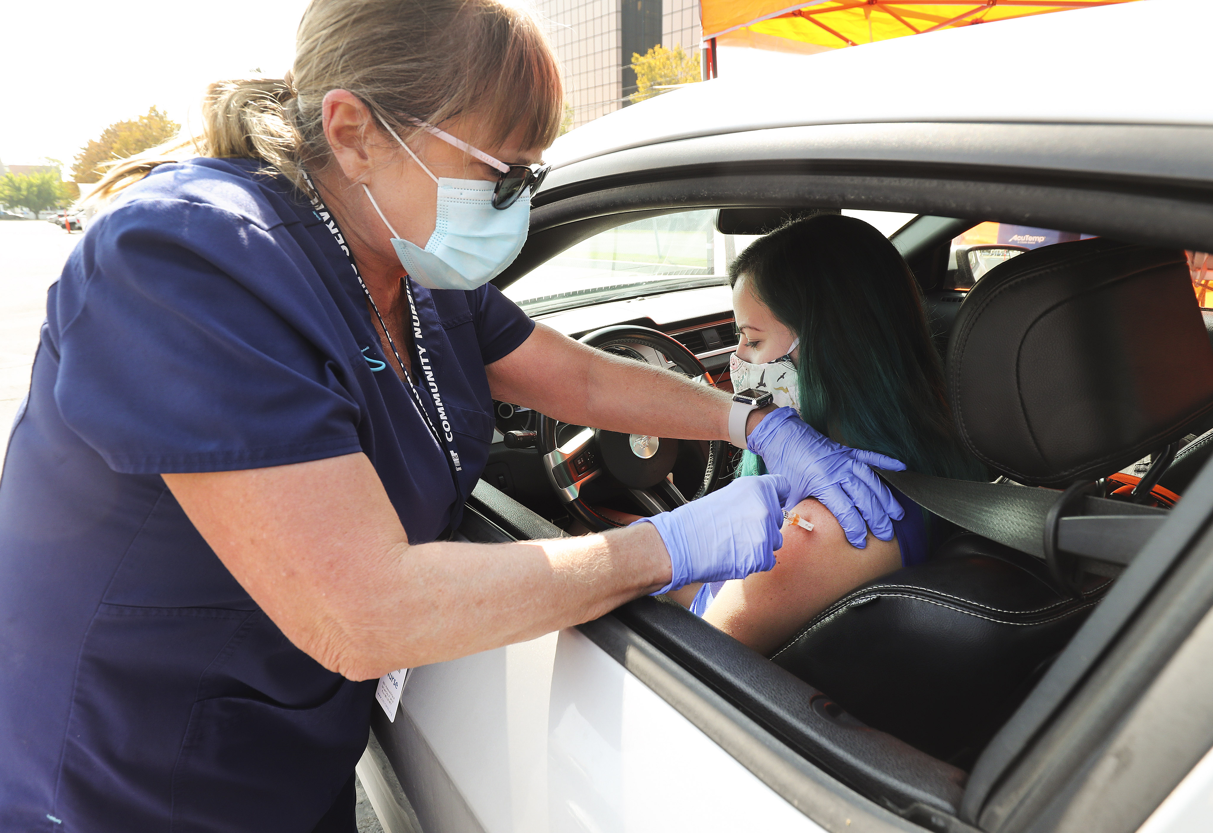 Registered nurse Kaylin Conant gives Kristina Boler a flu shot during a drive-thru clinic hosted by Community Nursing Services in Salt Lake City on Tuesday, Oct 6, 2020.