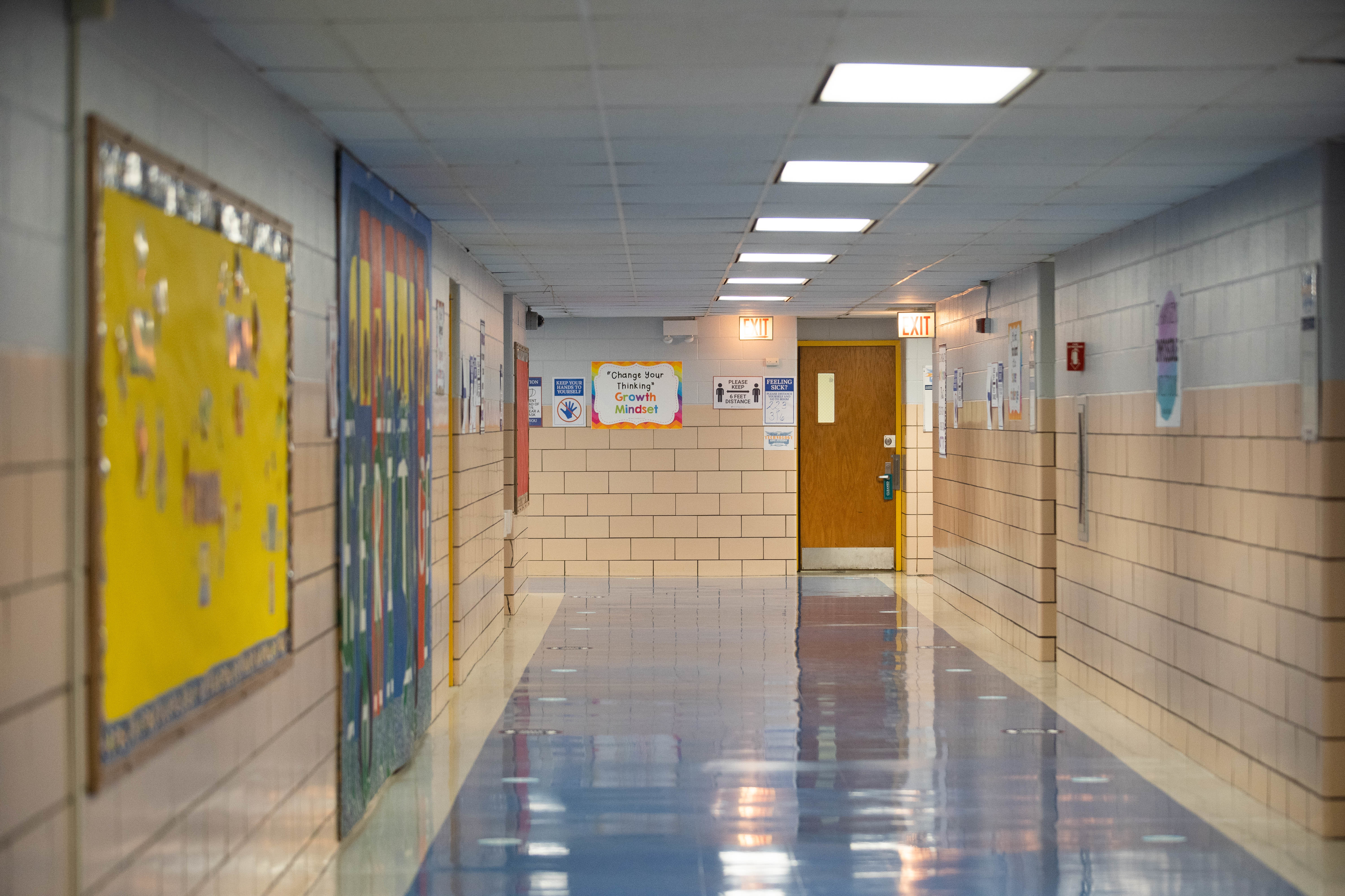 An empty hallway at Dr. Martin Luther King Jr. Academy of Social Justice in Englewood. America's closed schools are an educational crisis within a public health crisis.