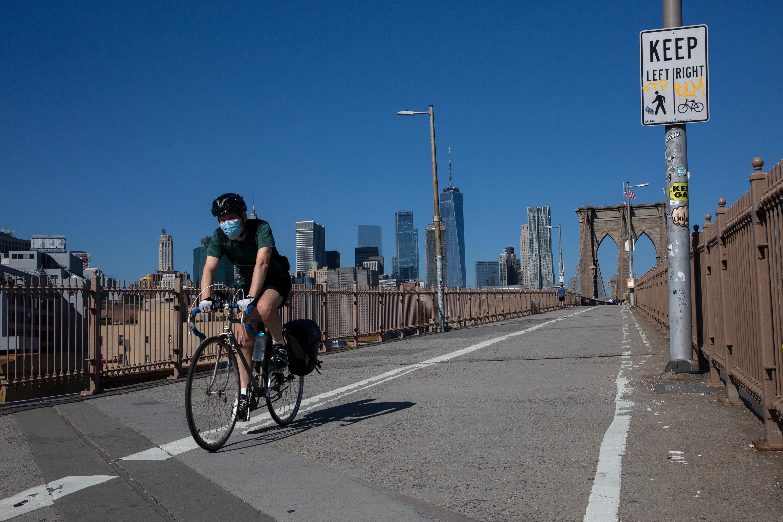 A cyclist travels over the Brooklyn Bridge, Oct. 14, 2020.
