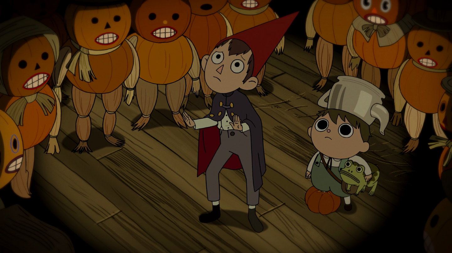 Wirt and Greg, surrounded by pumpkin people, plead with a giant pumpkin spirit.