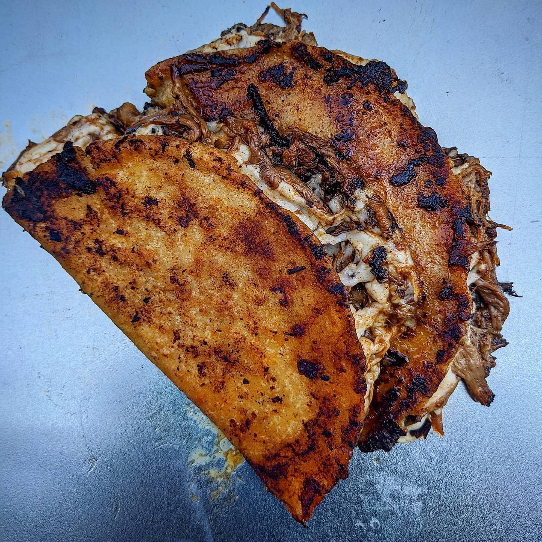 two cheesy, toasty birria tacos