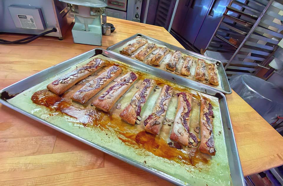 Sugar-coated bread sticks sit on a baking tray right out of the oven at Katsu Burger & Bakery.