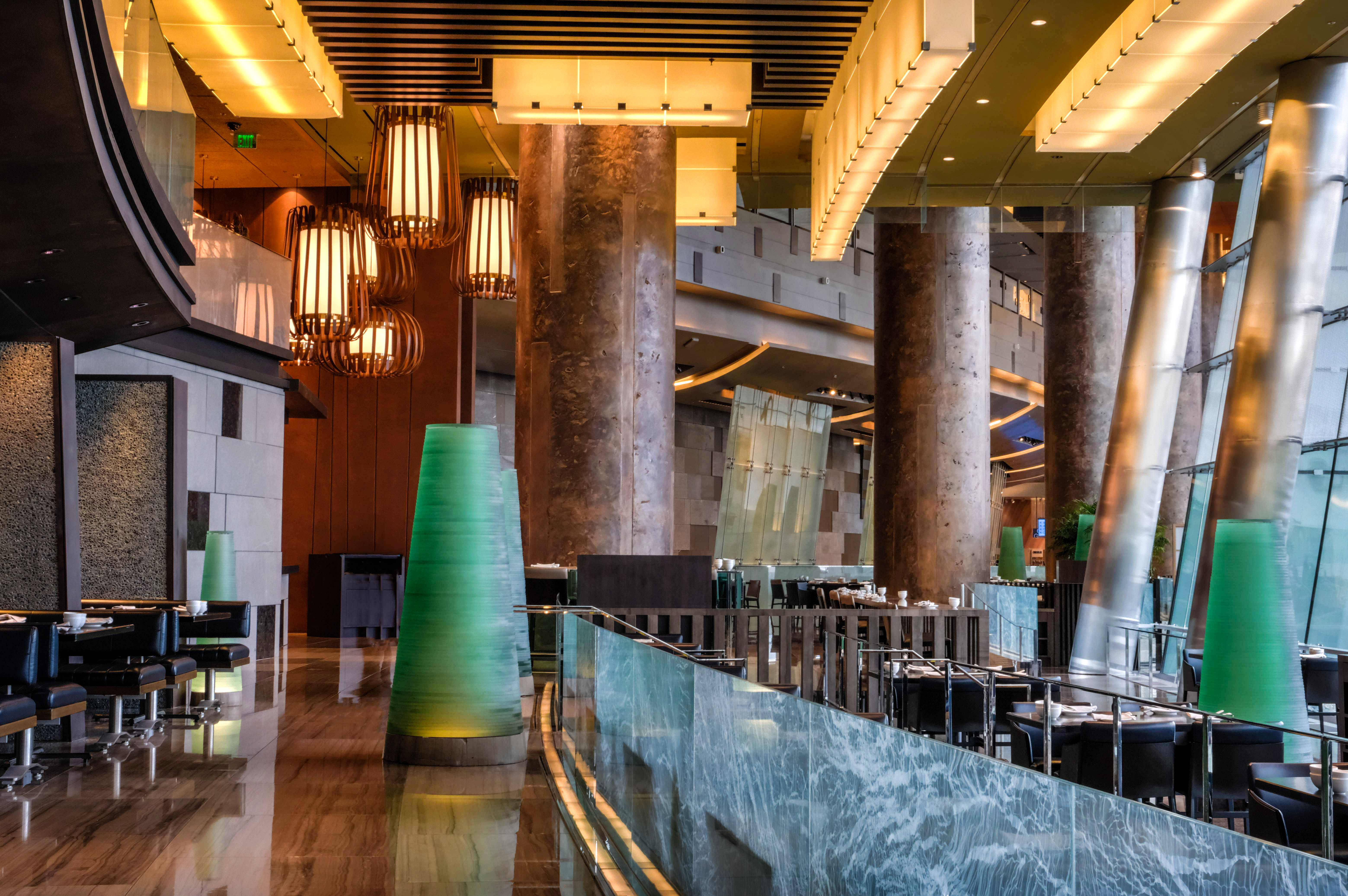 A restaurant dining room with green sculptures