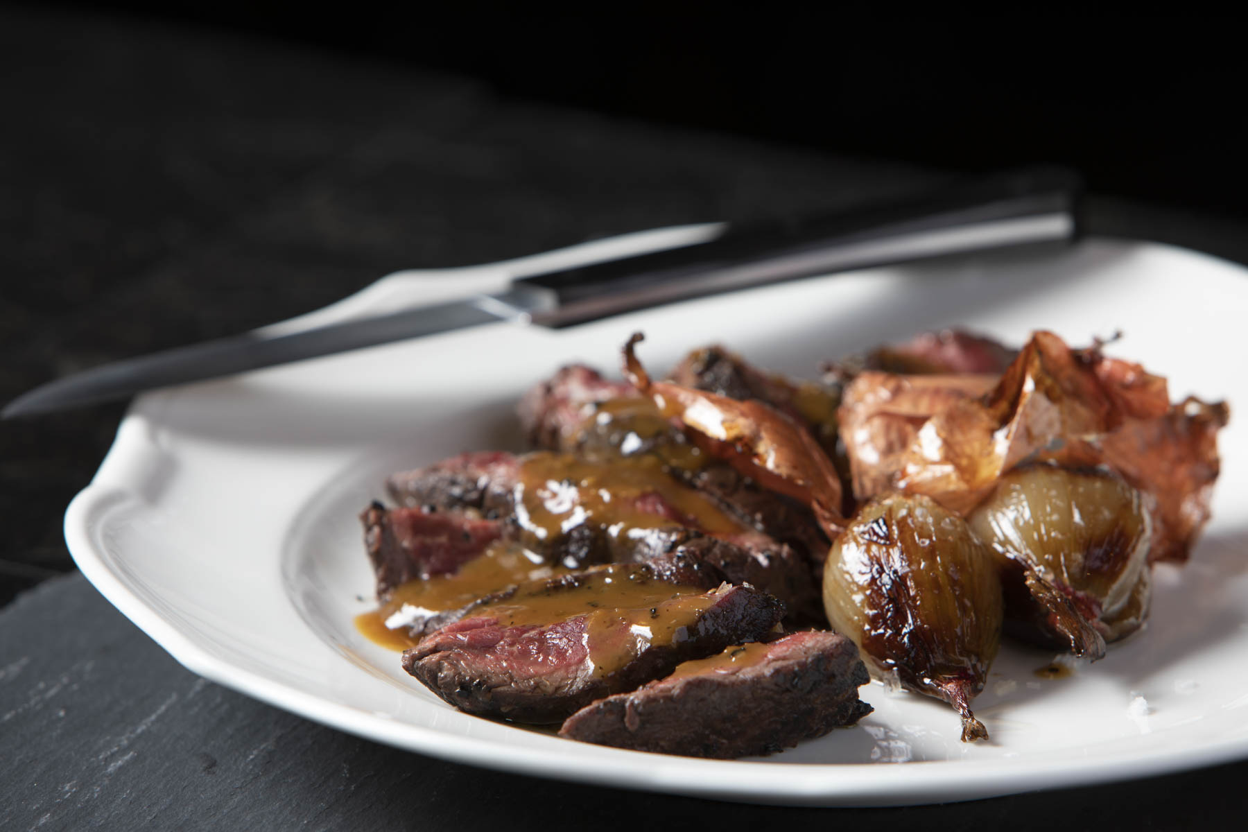 Steak with onions and sides at The Barish, Nancy Silverton's new Hollywood steakhouse