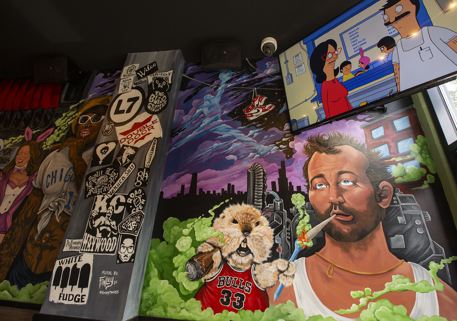 A huge wall mural of Chicago characters smoking weed.