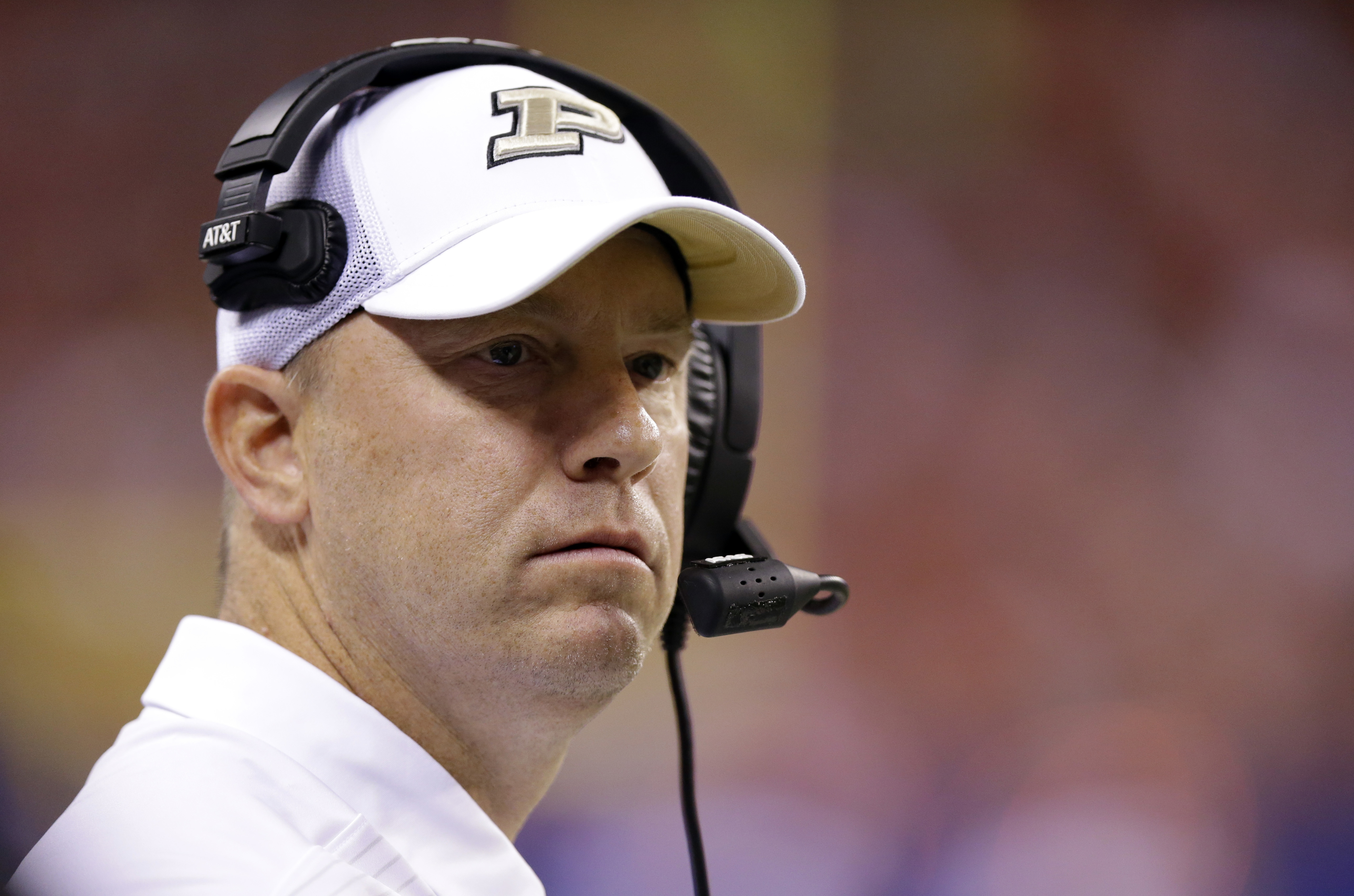 A second positive coronavirus test will keep Purdue football coach Jeff Brohm off the sideline this weekend.