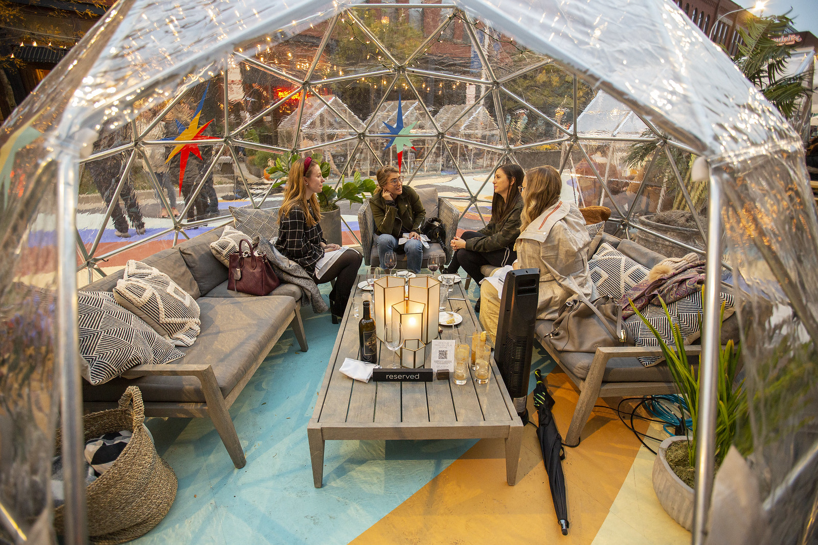 A plastic dome with people eating inside.
