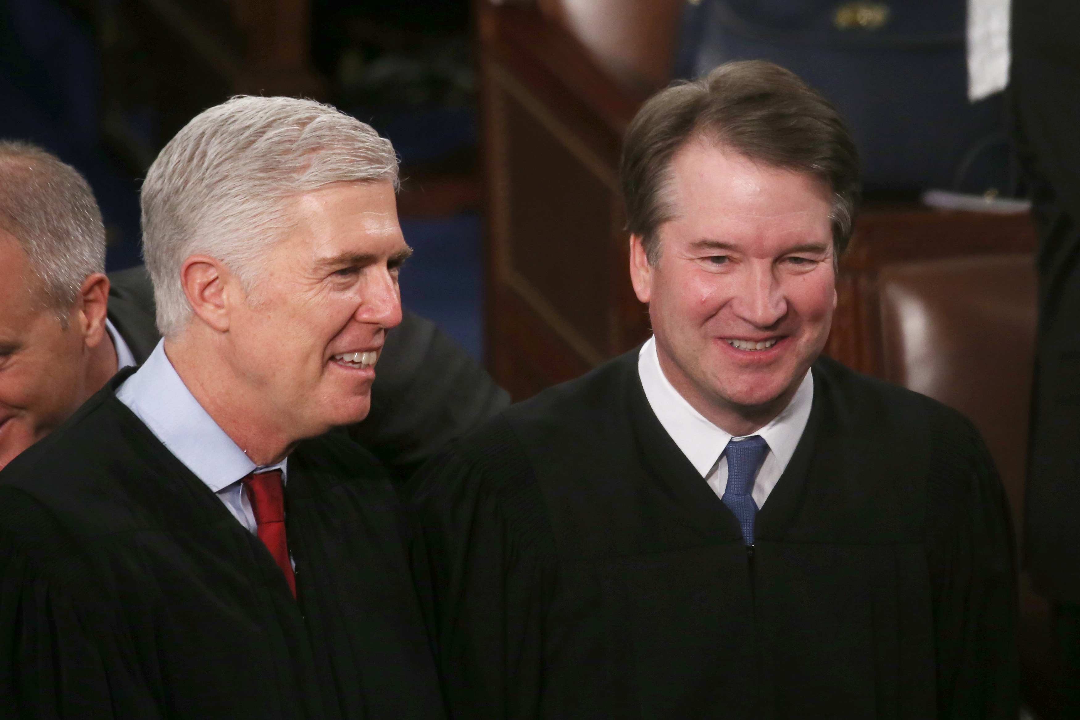 Supreme Court Justices Neil Gorsuch (L) and Brett Kavanaugh attend the State of the Union address in the chamber of the U.S. House of Representatives on February 04, 2020