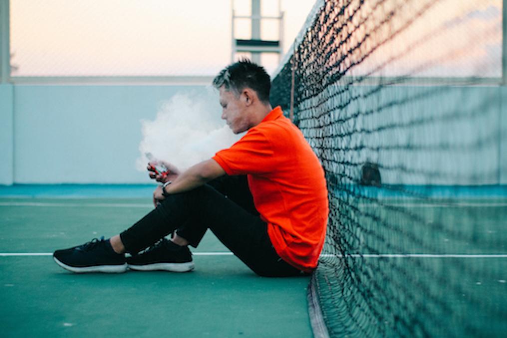 Teenage boy vaping
