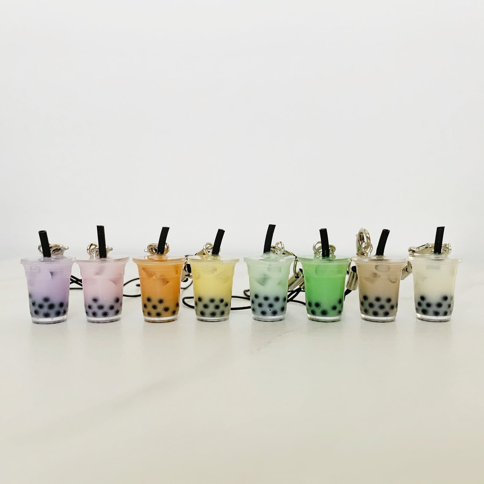 Boba-shaped keychains in an array of colors