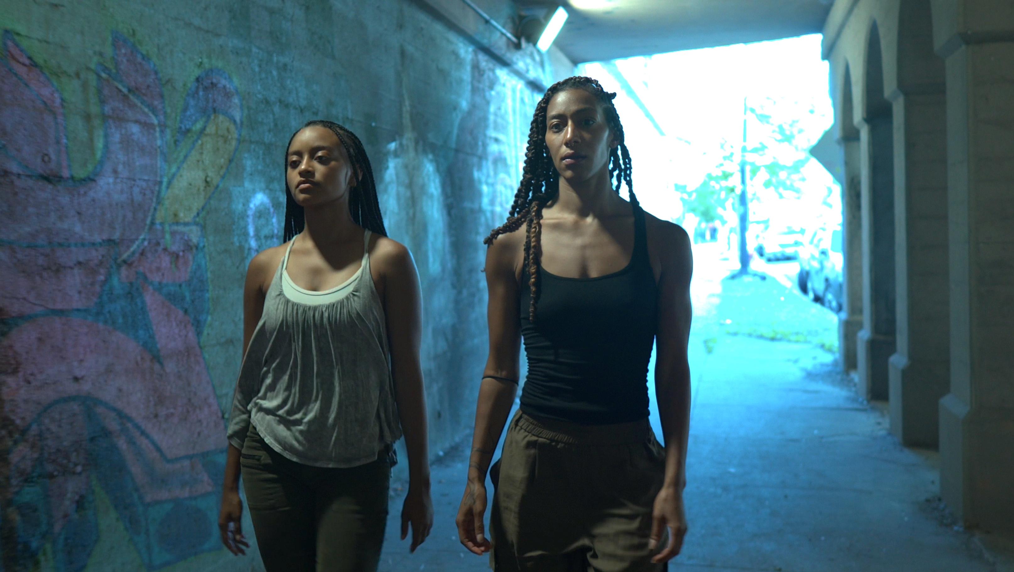 "Hubbard Street Dancer Alysia Johnson and artist Rena Butler in ""A Tale of Two"" by Rena Butler. Screenshot by director Talia Koylass"