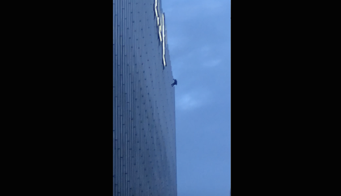 A man can be seen hanging off the side of Trump Tower, 401 N. Wabash Ave., on Oct. 18, 2020.