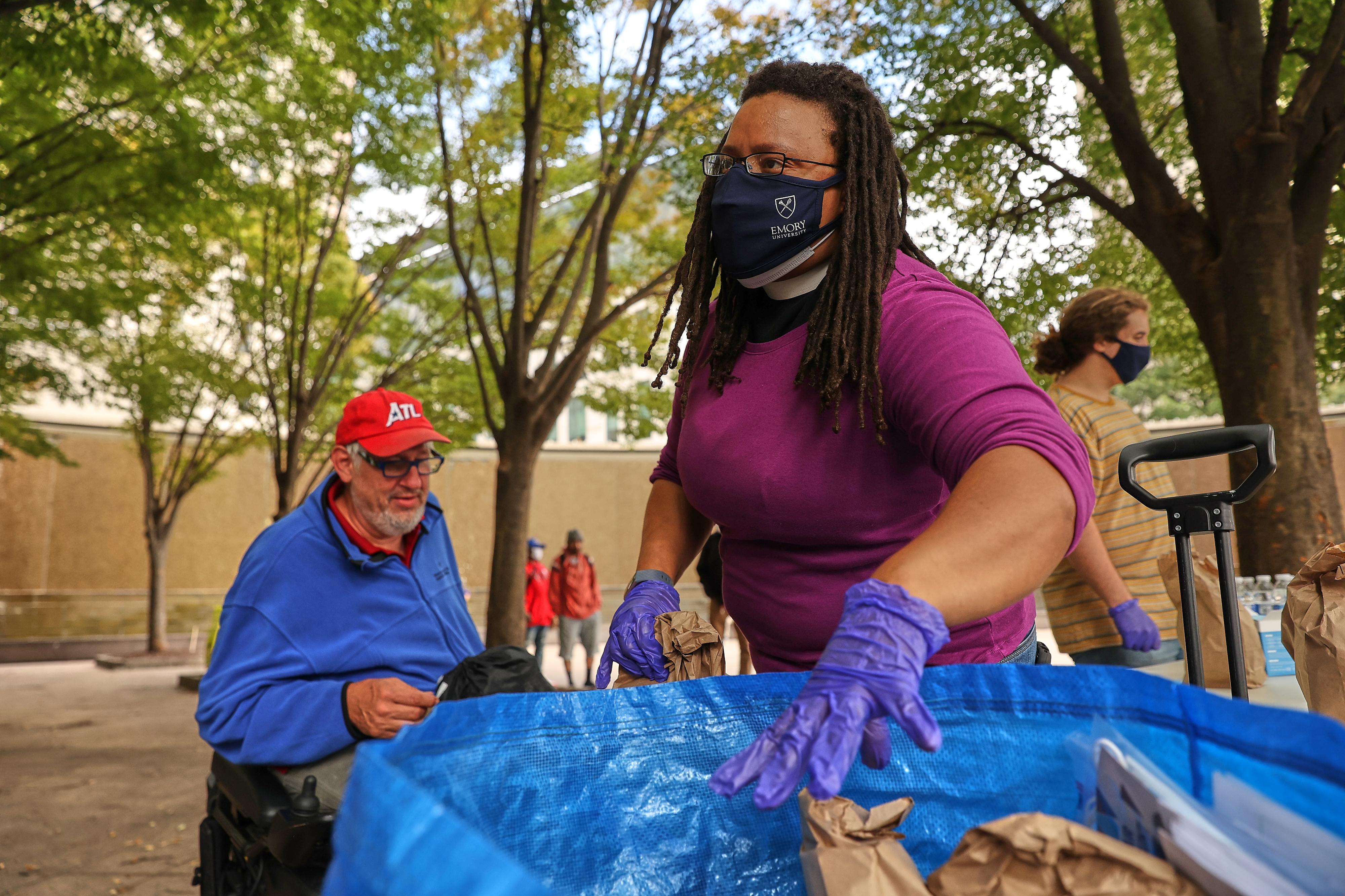 The Rev. Kim Jackson feeds the homeless at Woodruff Park in Atlanta, Georgia, on Sunday, Oct. 18, 2020.