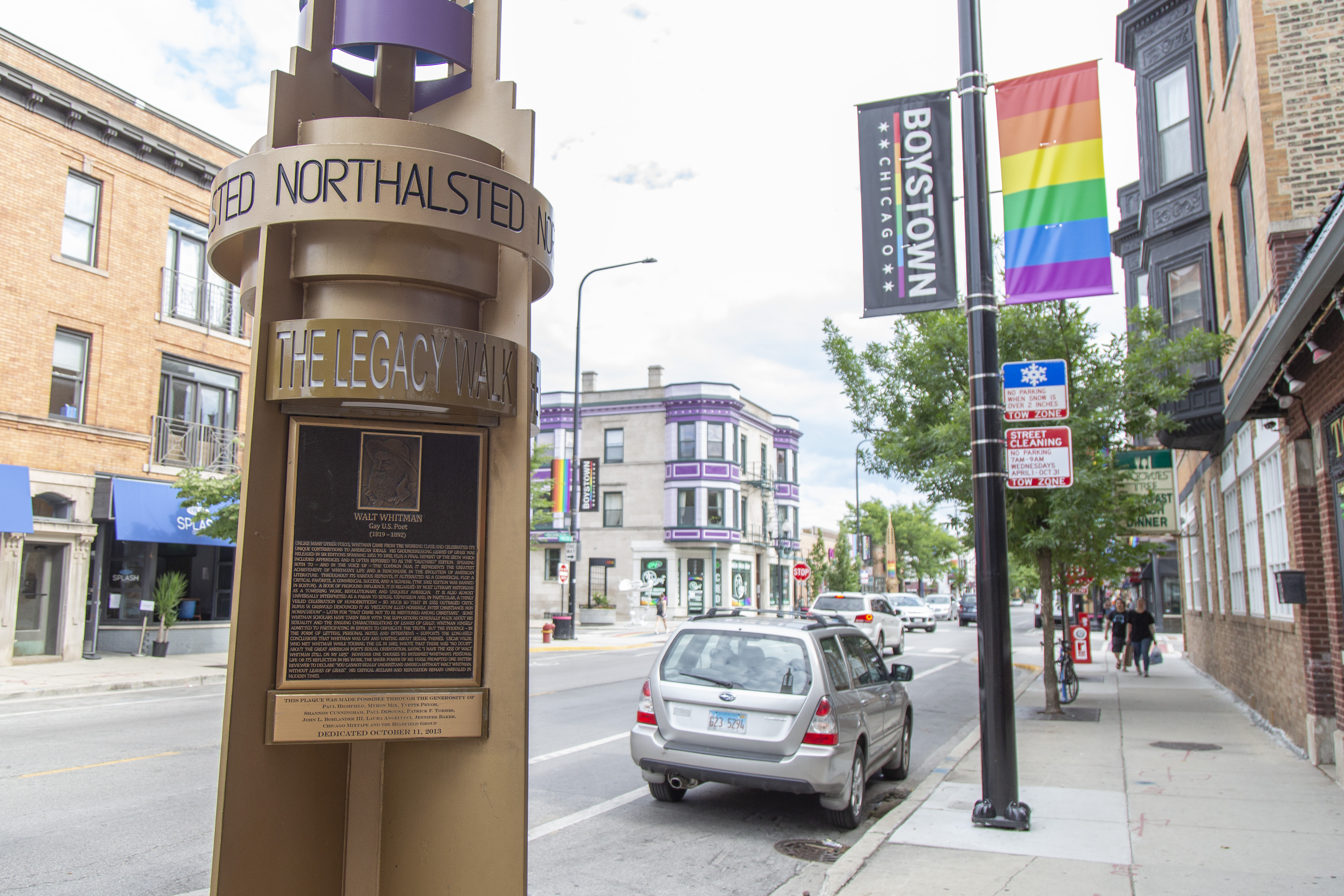 Rainbow pylons and plaques commemorating the life and work of notable LGBTQ individuals on Halstead St in Boystown, Lakeview.