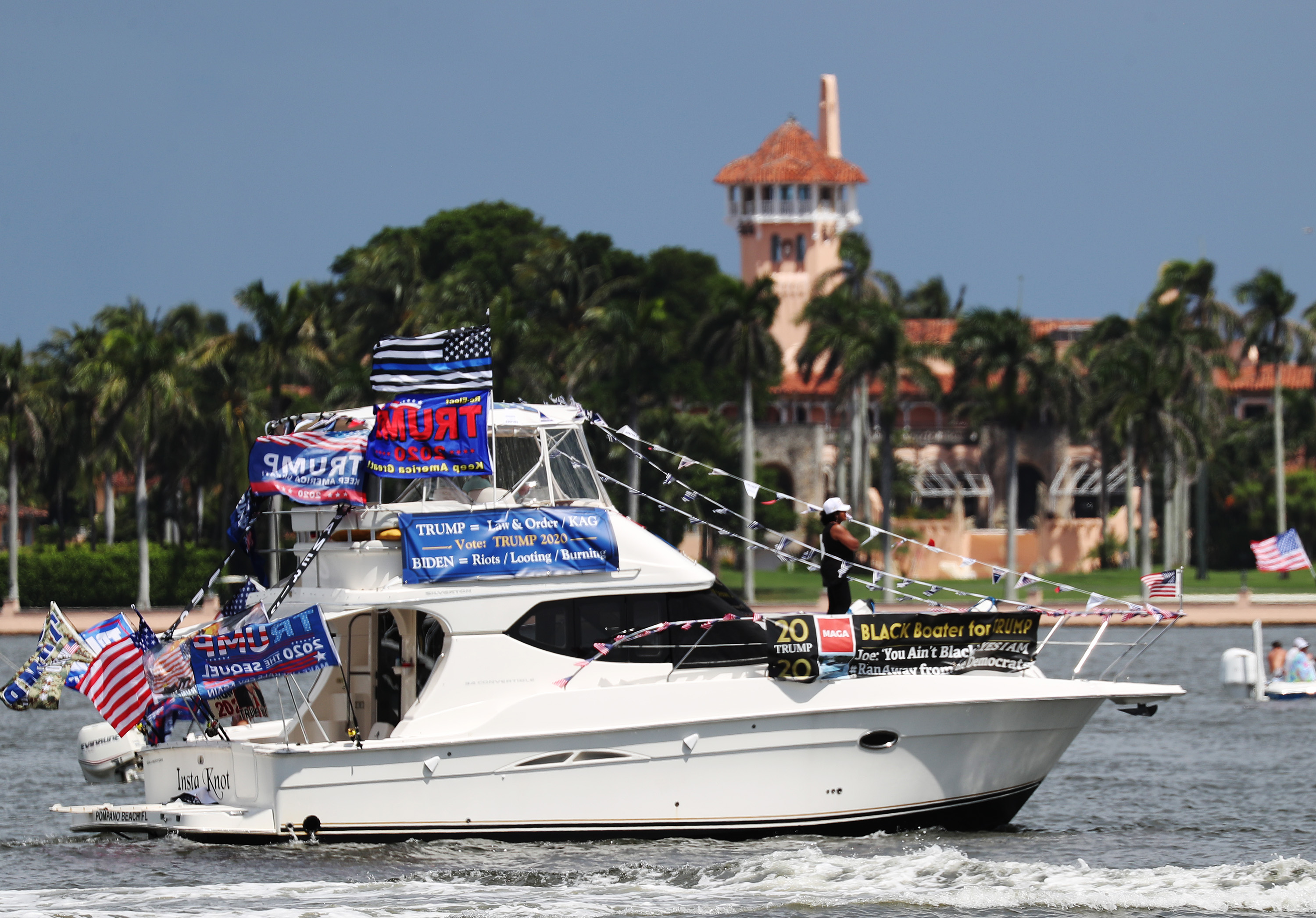 A boat sails just off the shore of President Donald Trump's home at Mar-a-Lago during a boat parade to support the president on September 7 in West Palm Beach, Florida.