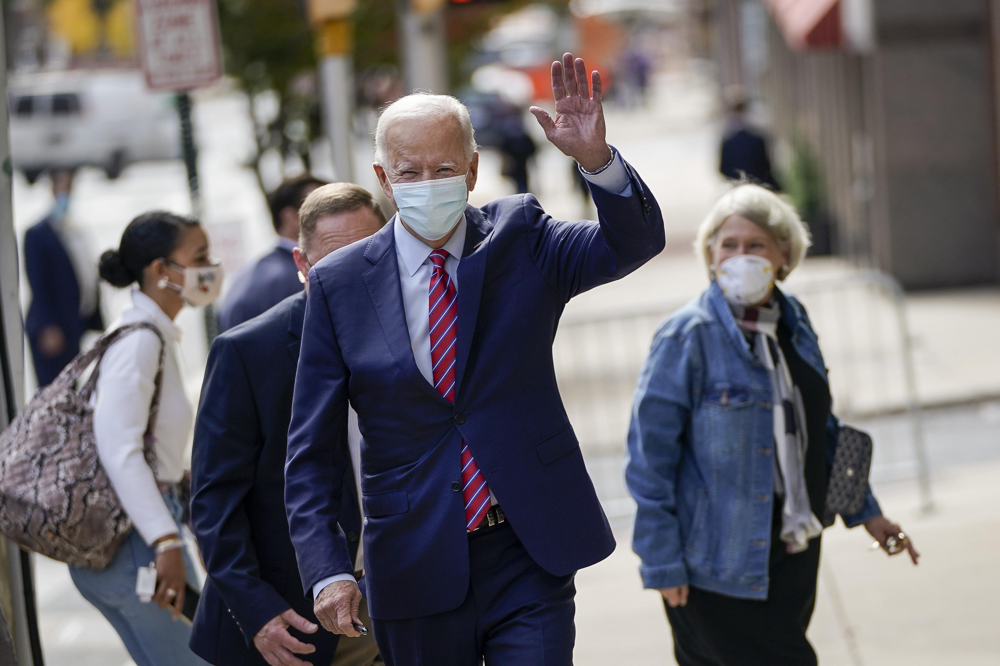 Democratic presidential nominee Joe Biden waves as he departs The Queen theater on October 19, 2020 in Wilmington, Delaware.