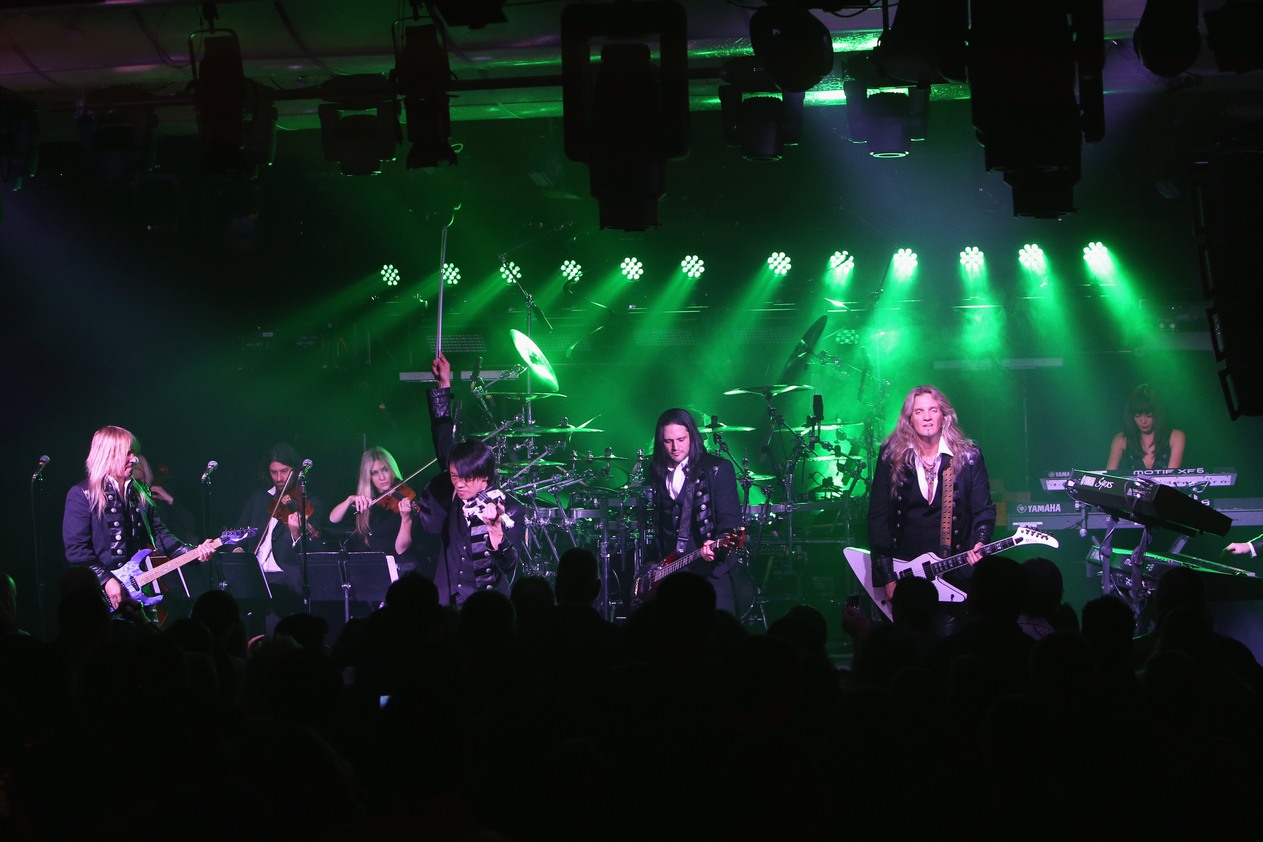 Chris Caffery (from left), Roddy Chong, David Z and Joel Hoekstra of Trans-Siberian Orchestra perform onstage at The iHeartRadio Theater in New York in 2014.