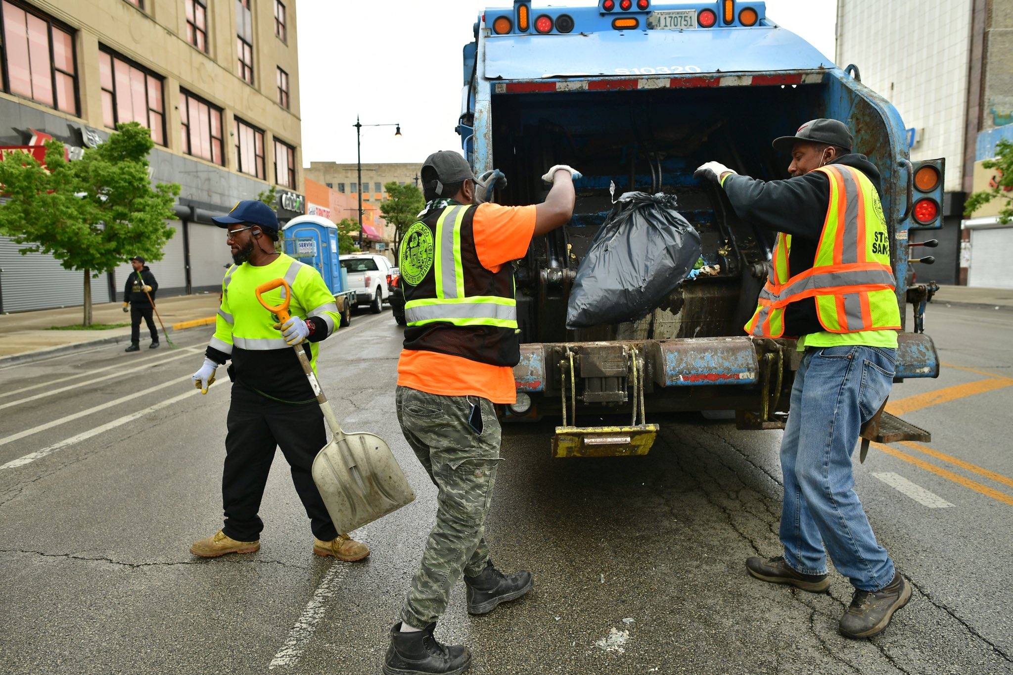 The city's contract with garbage collection workers requires three people to staff each truck — something Mayor Lori Lightfoot wants to reconsider.