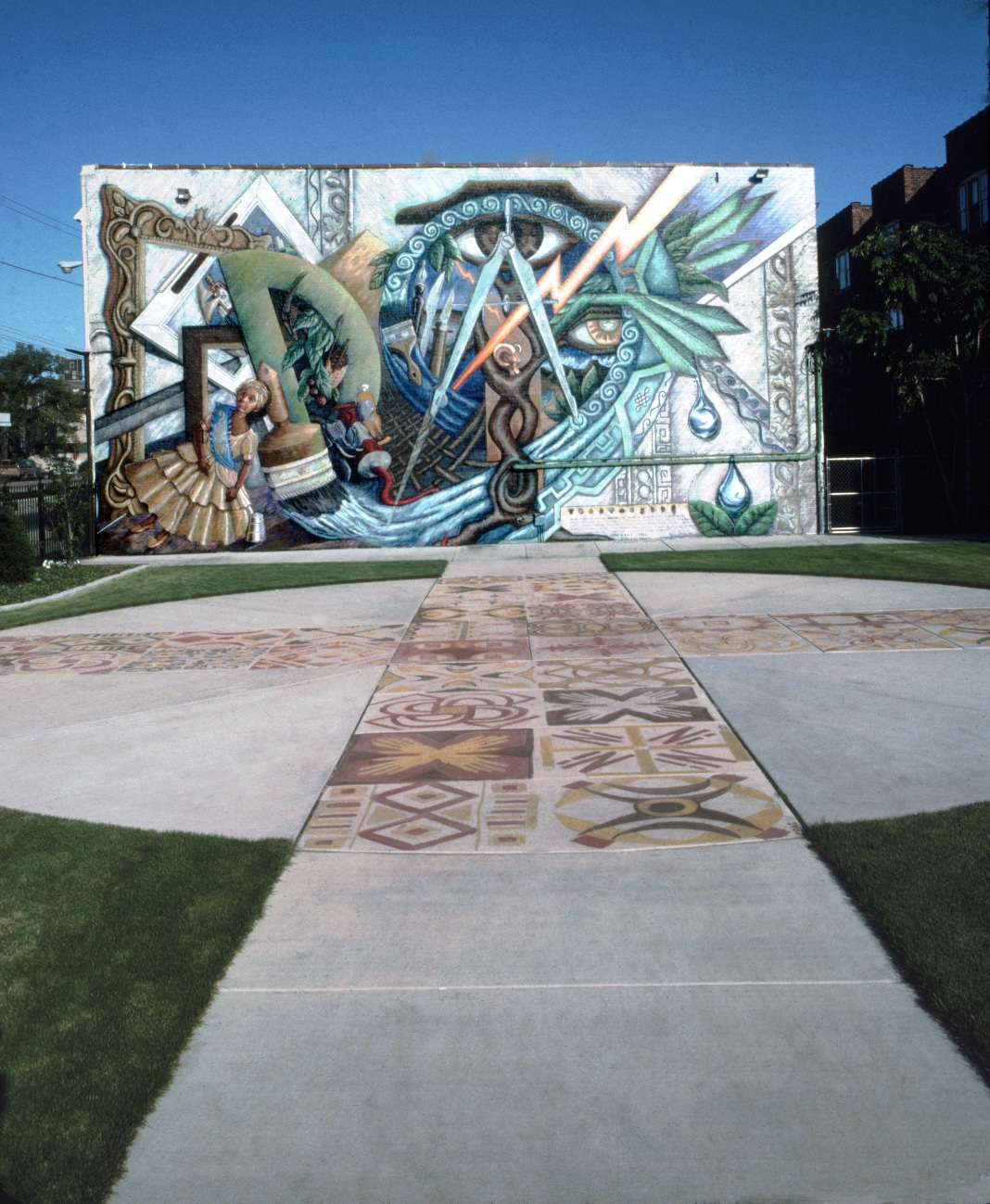 """This 1991 mural at 1801 E. 71st St. by Olivia Gude and Marcus Akinlana, titled """"Where There is Discord, Harmony; The Power of Art,"""" includes multicultural and spiritual symbols."""