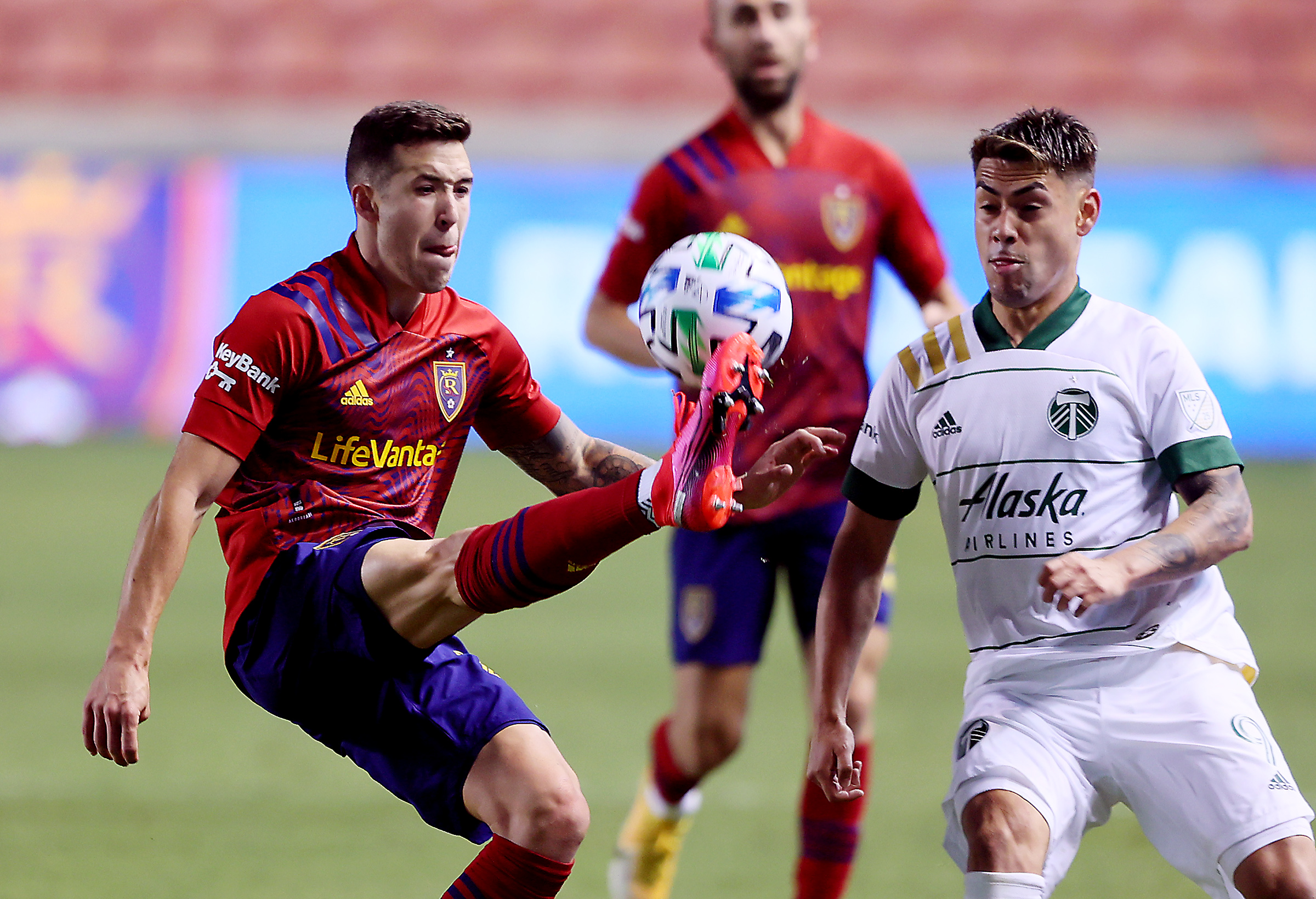 Real Salt Lake defender Aaron Herrera (22) battle Portland Timbers forward Felipe Mora (9) for the ball as RSL and Portland play an MLS soccer game at Rio Tinto Stadium in Sandy on Wednesday, Oct. 14, 2020. RSL won 2-1.