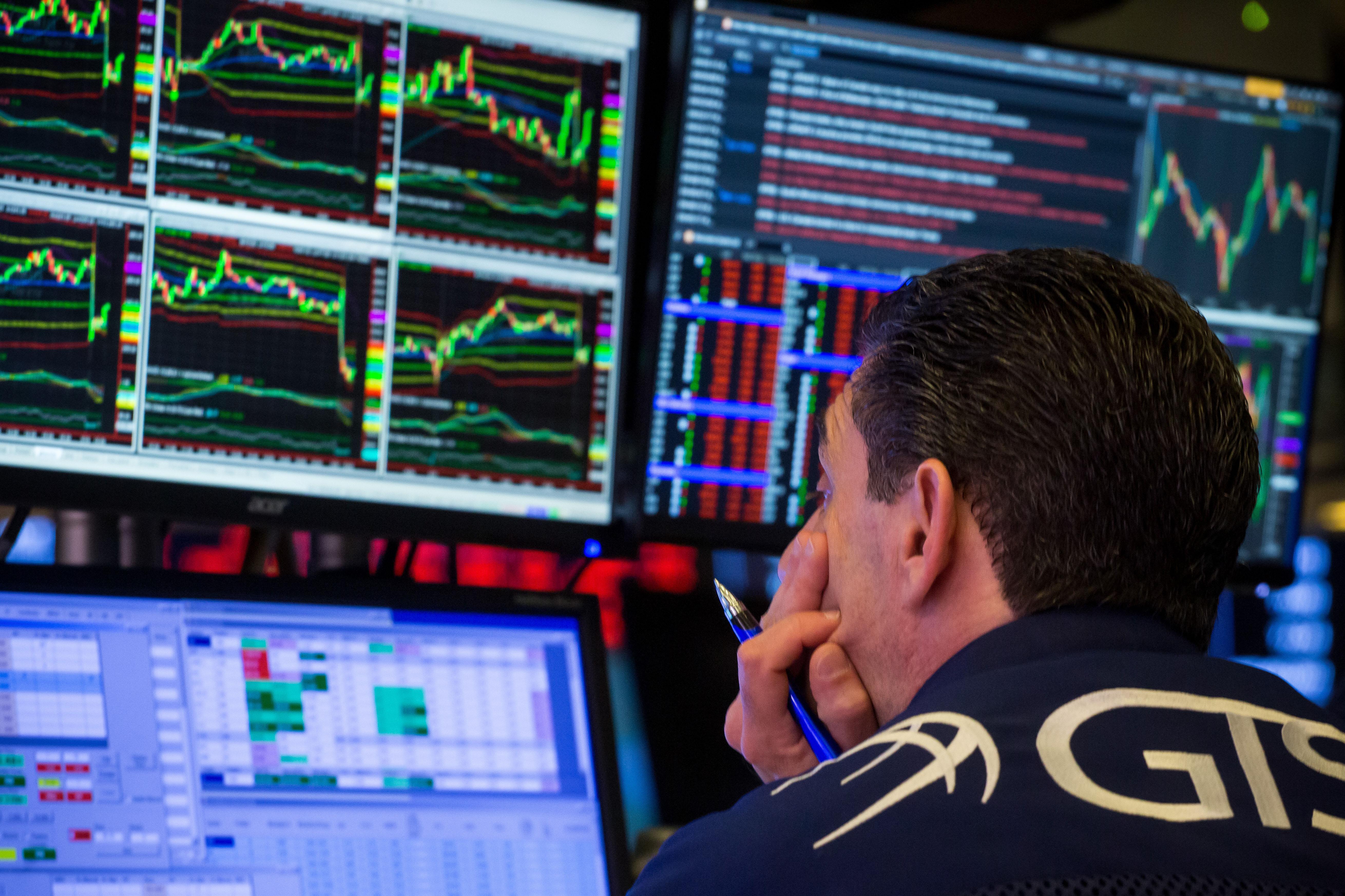 Trader looking at screens