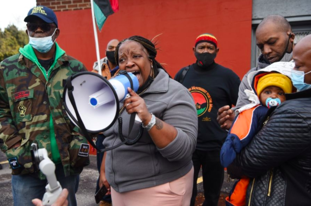 Clifftina Johnson, mother of Tafara Williams, speaks during a Black Lives Matter Rally in Waukgan Saturday as Marcellis Stinnette Jr., age seven months, is held by his aunt, Sharay Johnson.