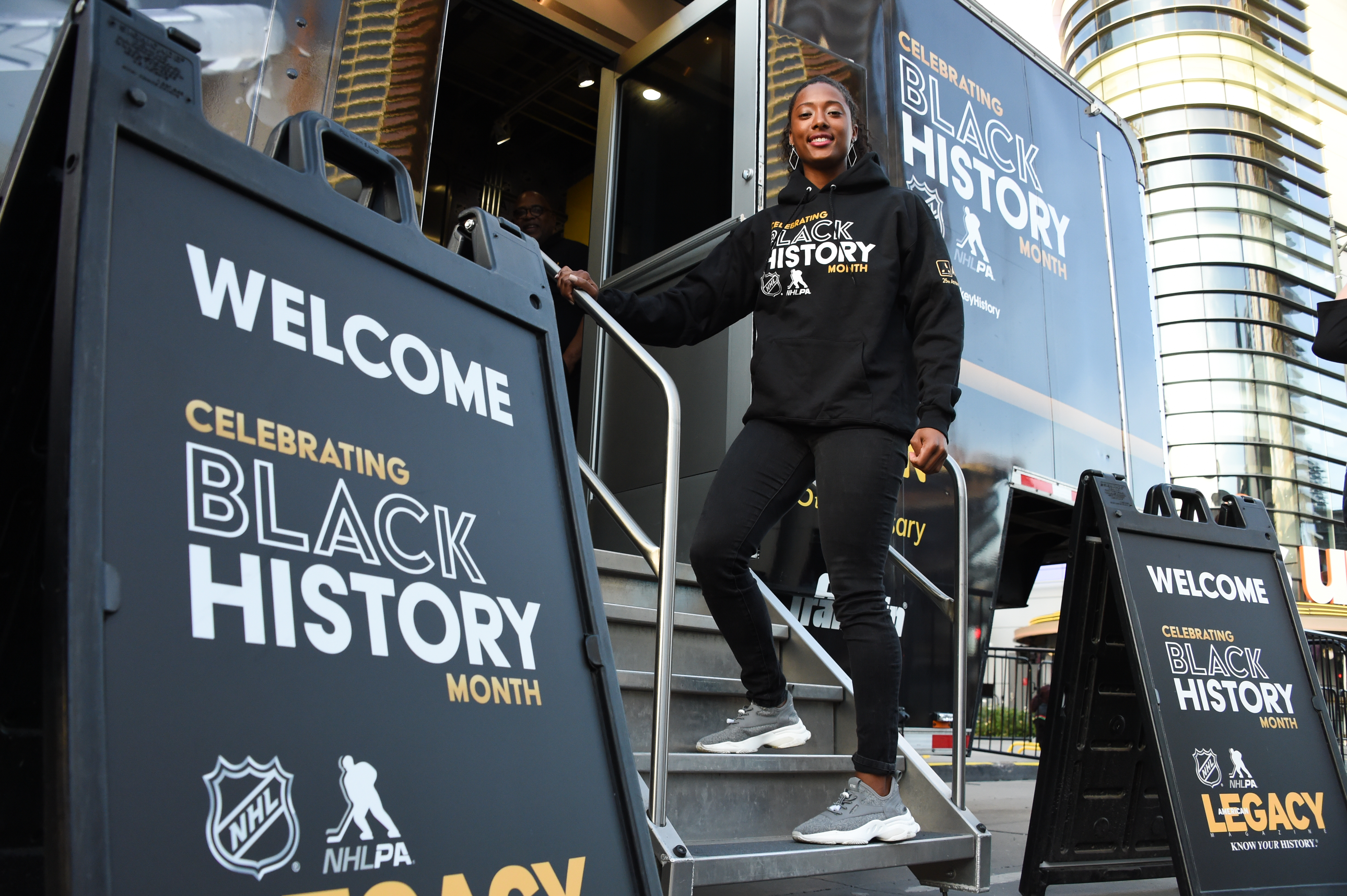 Blake Bolden, the first black NWHL player, poses in front of the Black Hockey History Museum before the game between the Pittsburgh Penguins and the Los Angeles Kings at STAPLES Center on February 26, 2020 in Los Angeles, California.