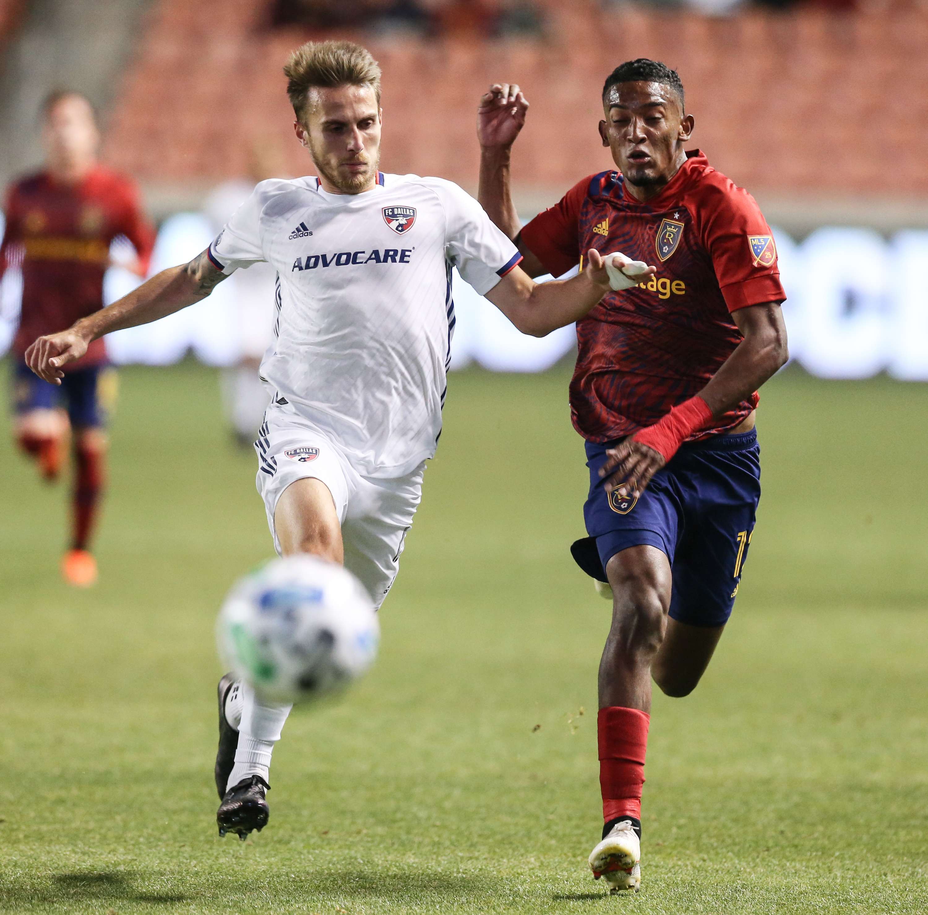 Real Salt Lake forward Douglas Martinez (12) rushes to the ball against FC Dallas defender Bressan (4) during an MLS soccer game at Rio Tinto Stadium in Sandy on Saturday, Oct. 24, 2020.