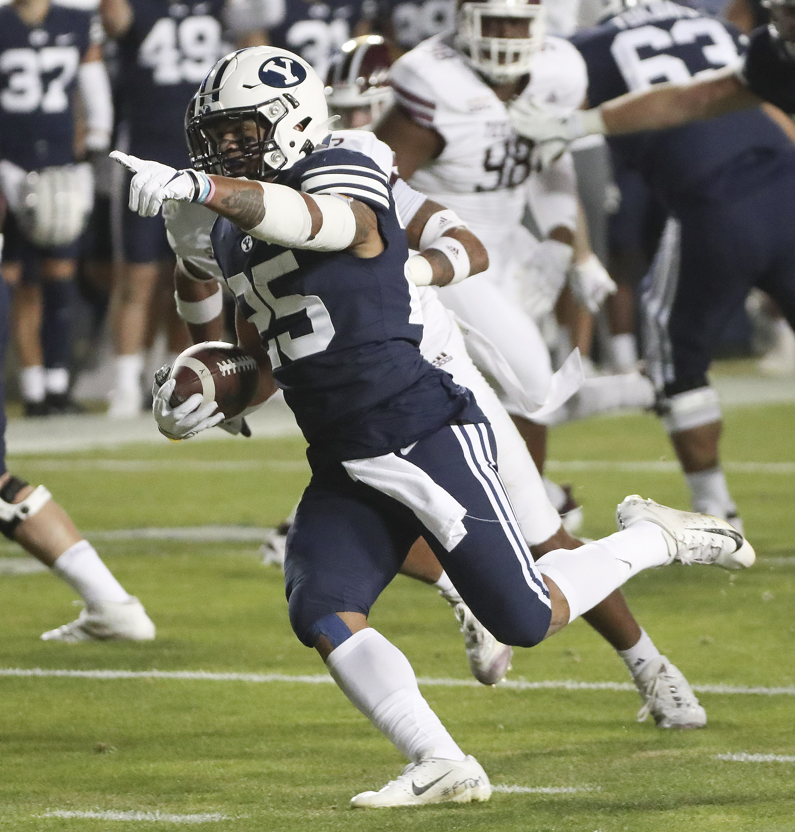 Brigham Young Cougars running back Tyler Allgeier (25) scores a touchdown against the Texas State Bobcats in Provo on Saturday, Oct. 24, 2020.