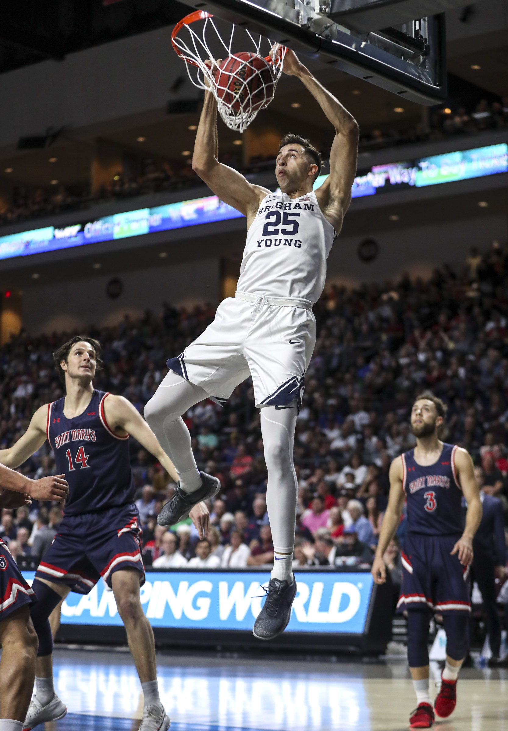 Brigham Young Cougars forward Gavin Baxter (25) throws down a dunk during the BYU and Saint Mary's WCC semifinal game at the Orleans Arena in Las Vegas on Monday, March 9, 2020.
