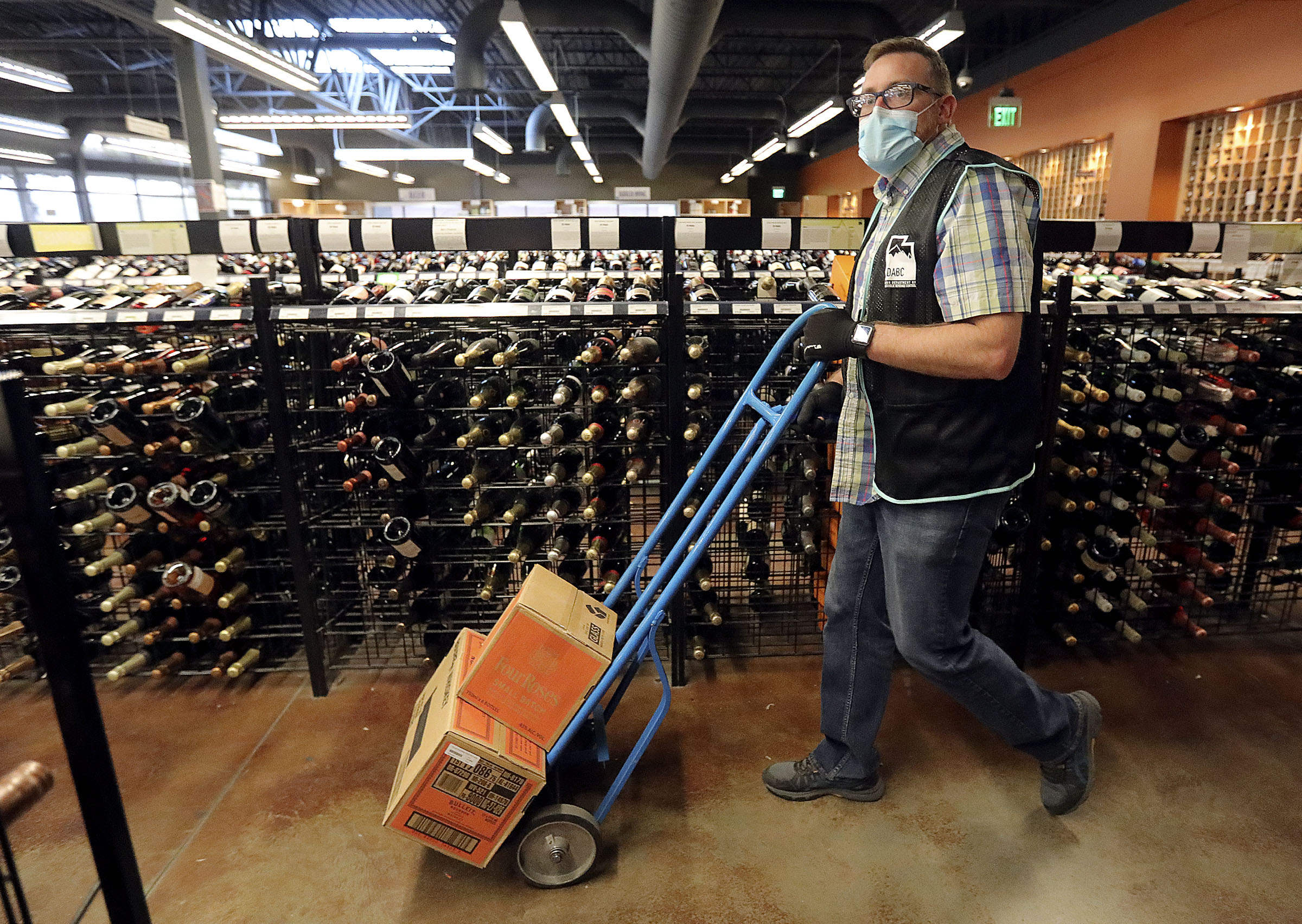 Justin Robertson, a full-time staffer, works atstate liquor storein Salt Lake City on Friday, Oct. 23, 2020.