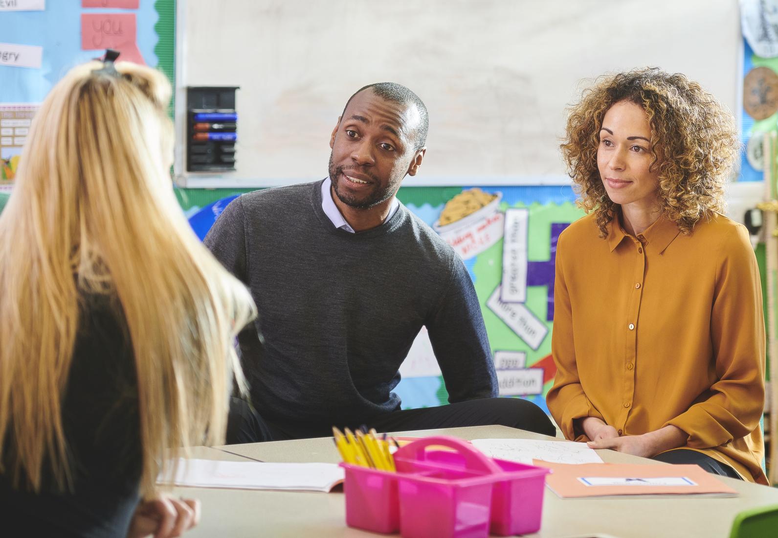 Parents in a parent teacher meeting.