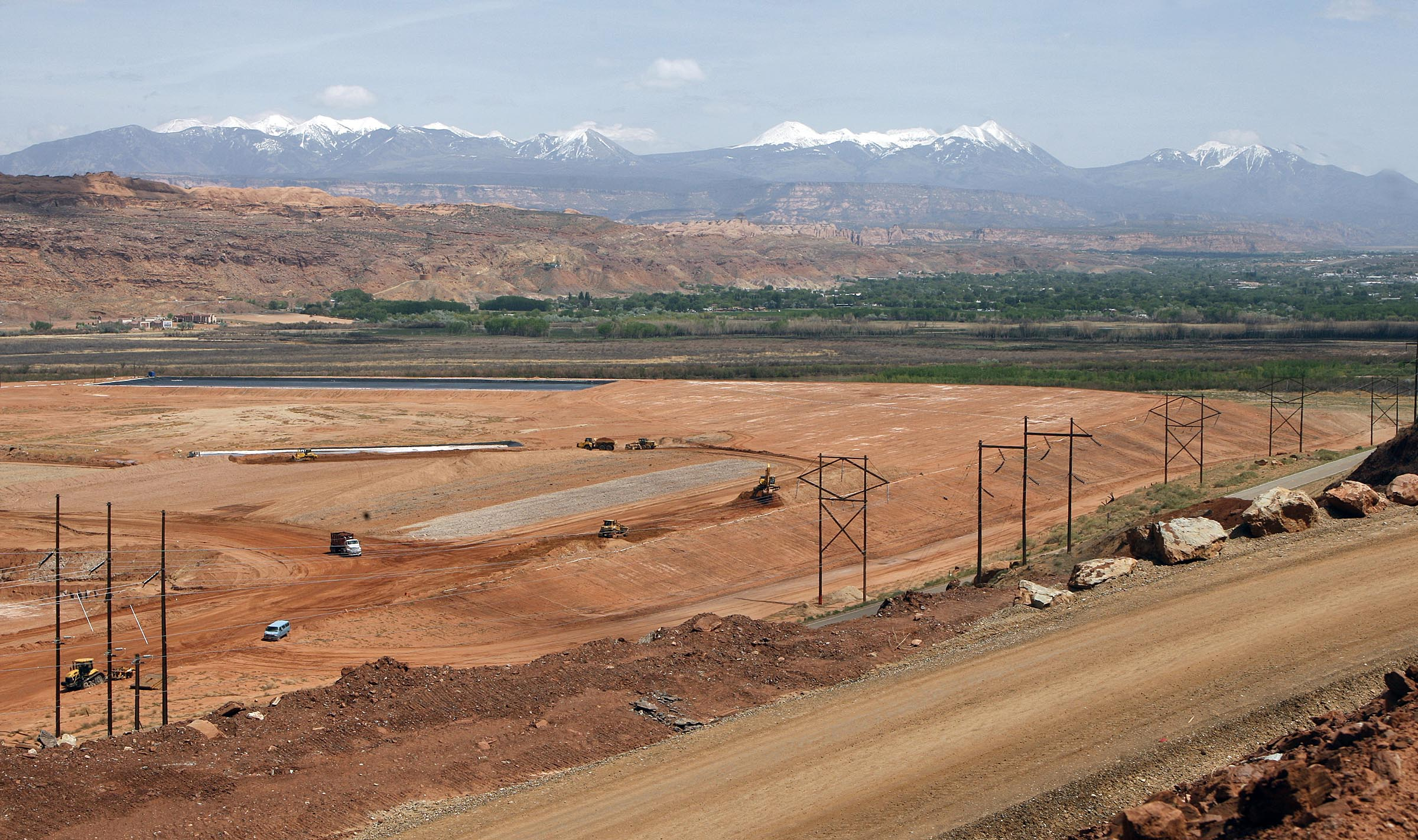 The Altas Mill uranium tailings site is pictured in 2001 with the city of Moab in the background. The radioactive tailings removal project, playing out near the banks of the Colorado River, reached another milestone with the announcement that 11 million tons of the material have safely been removed to a disposal site.