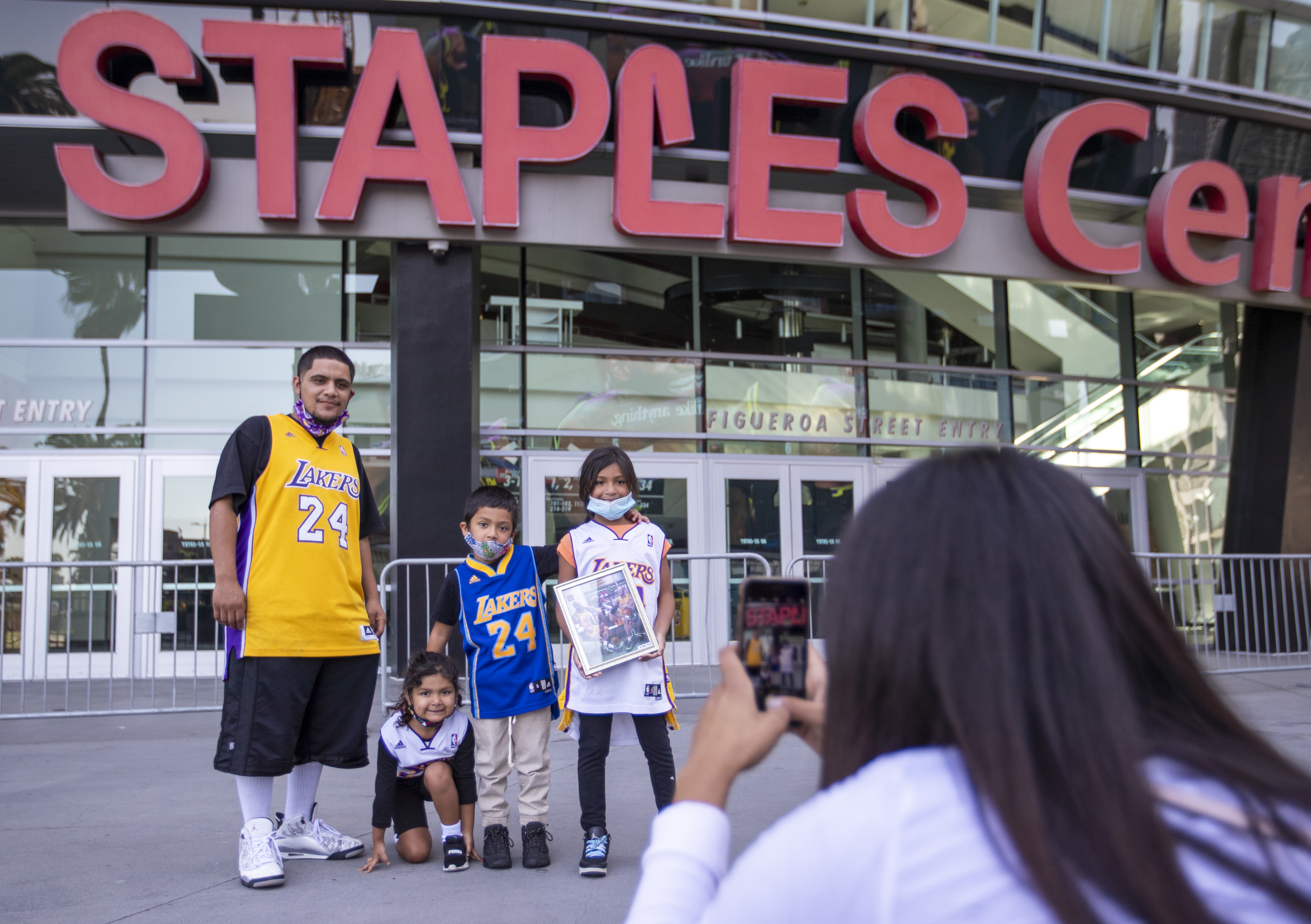 Lakers fans take photos in front of the Staples Center after the Lakers championship win