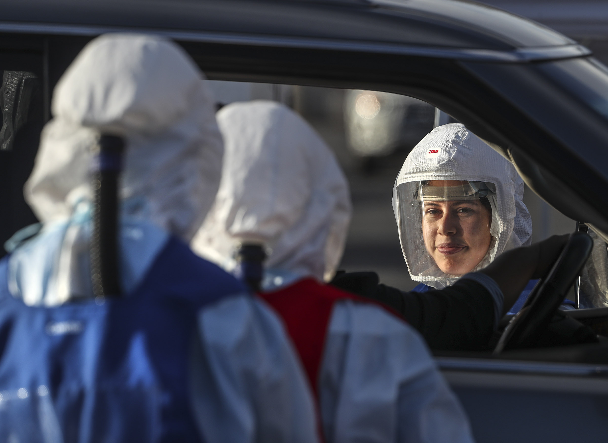 Sonia Gutierrez, a Salt Lake County mobile tester, smiles as she prepare to administer a COVID-19 test at the county's testing site in the Maverik Center parking lot in West Valley City on Tuesday, Oct. 27, 2020.