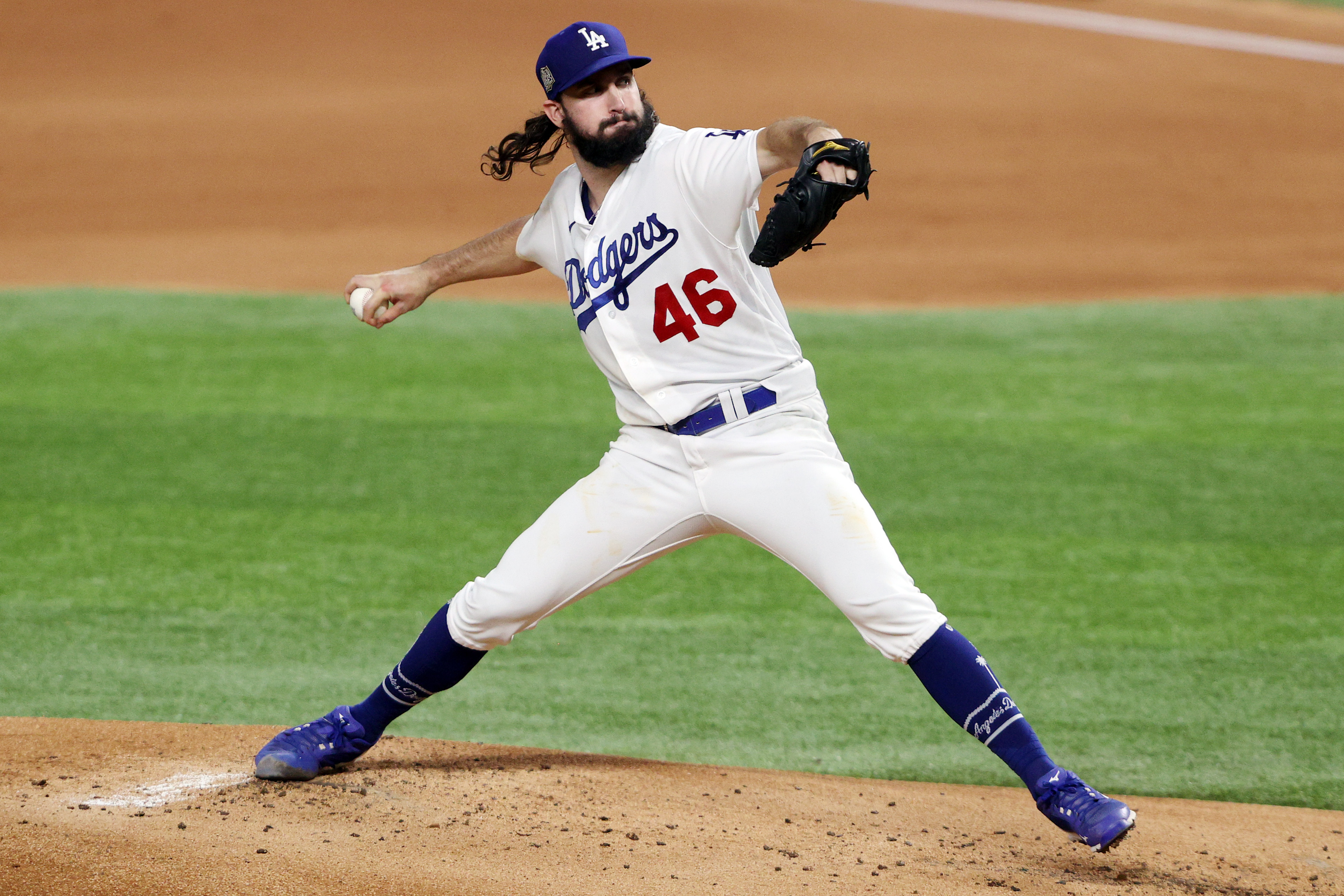 Tony Gonsolin of the Los Angeles Dodgers delivers the pitch against the Tampa Bay Rays during the second inning in Game Two of the 2020 MLB World Series at Globe Life Field on October 21, 2020 in Arlington, Texas.