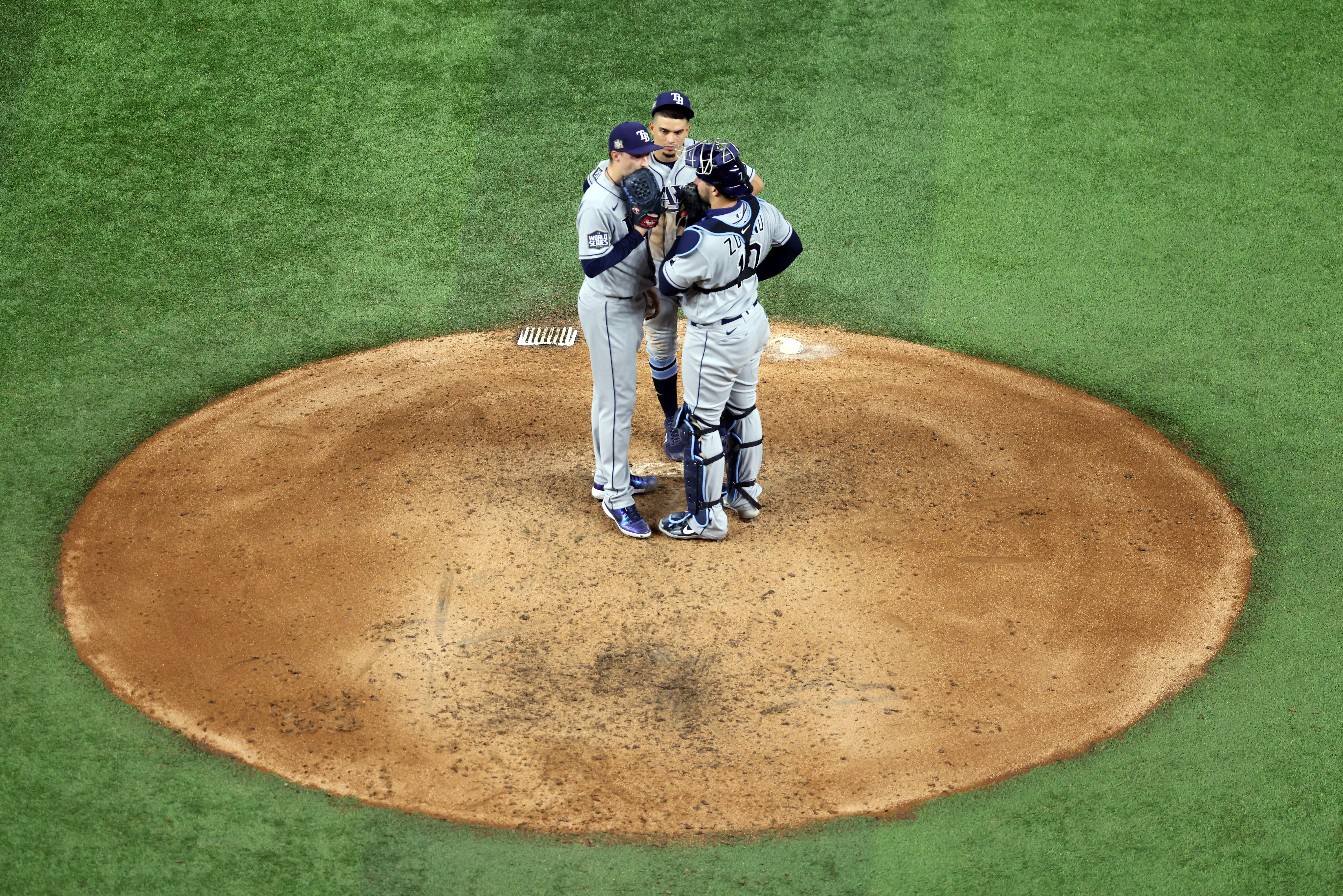 Blake Snell #4 of the Tampa Bay Rays receives a mound visit against the Los Angeles Dodgers during the fifth inning in Game Two of the 2020 MLB World Series at Globe Life Field on October 21, 2020 in Arlington, Texas.
