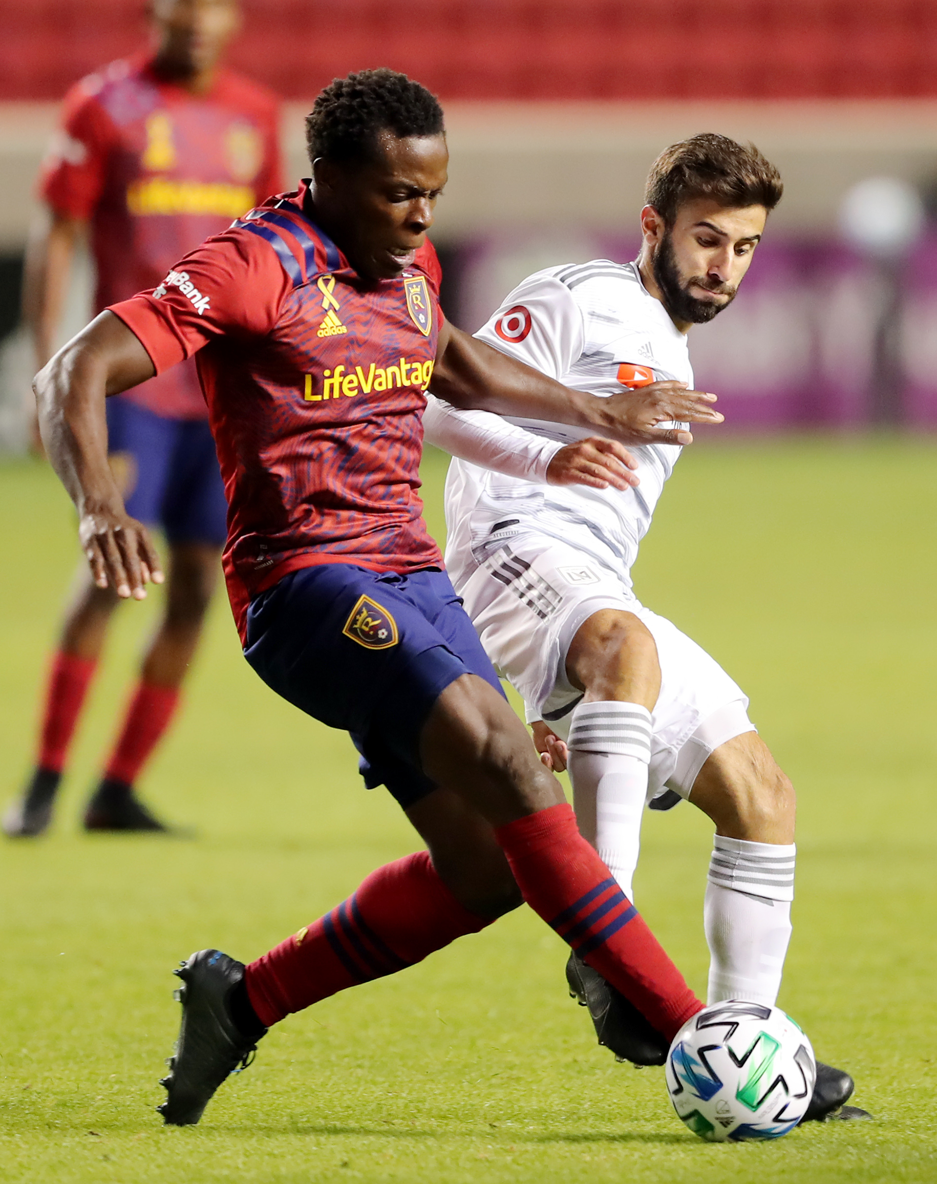 Real Salt Lake defender Nedum Onuoha (14) and Los Angeles FC forward Diego Rossi (9) battle for the ball as Real Salt Lake and Los Angeles FC play an MLS game at Rio Tinto Stadium in Sandy on Wednesday, Sept. 9, 2020. RSL won 3-0.