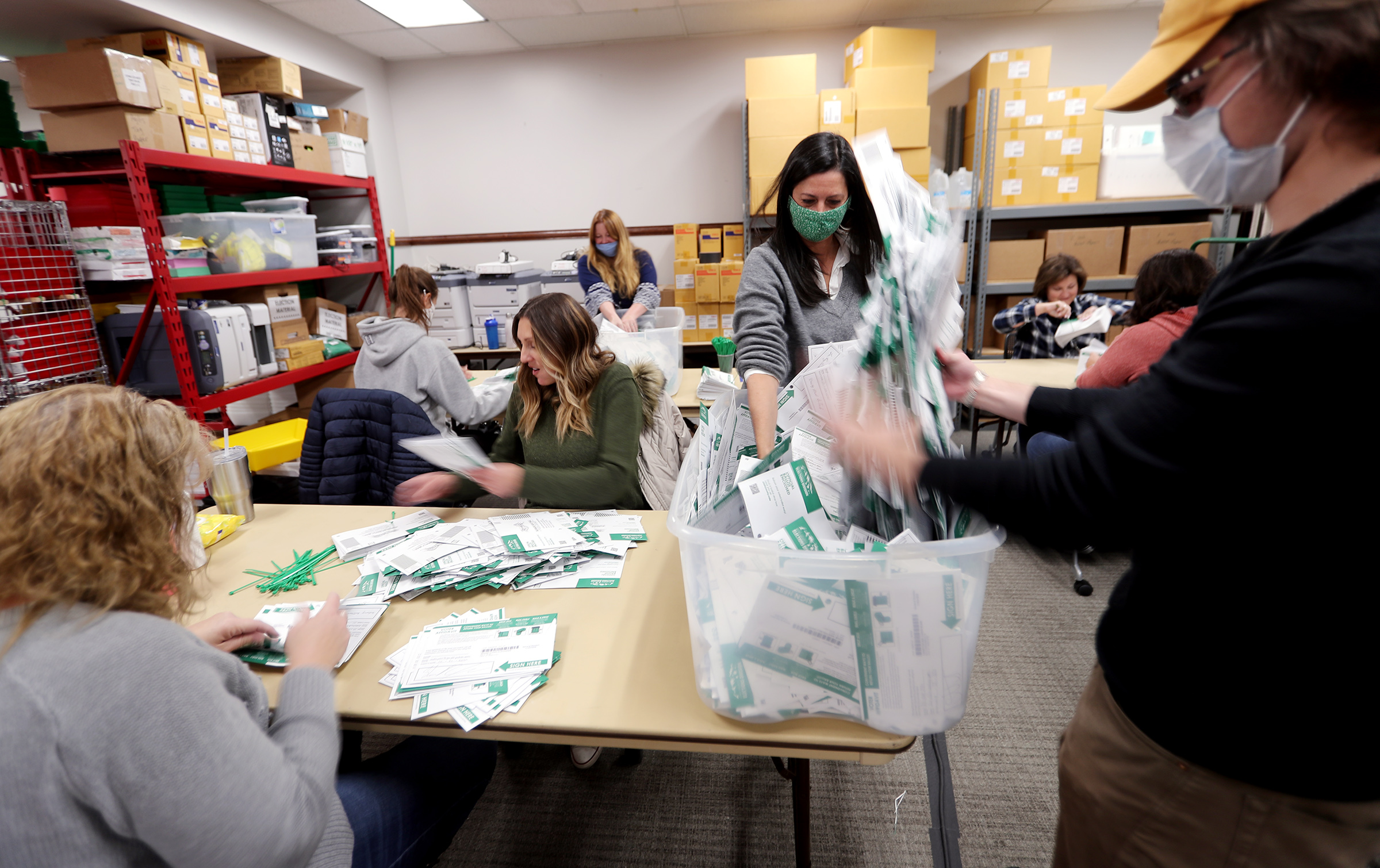Workers go through every envelope making sure all the ballots have been taken out and counted at the Utah County Clerk/Auditor's Office in Provo on Tuesday, Oct. 27, 2020.