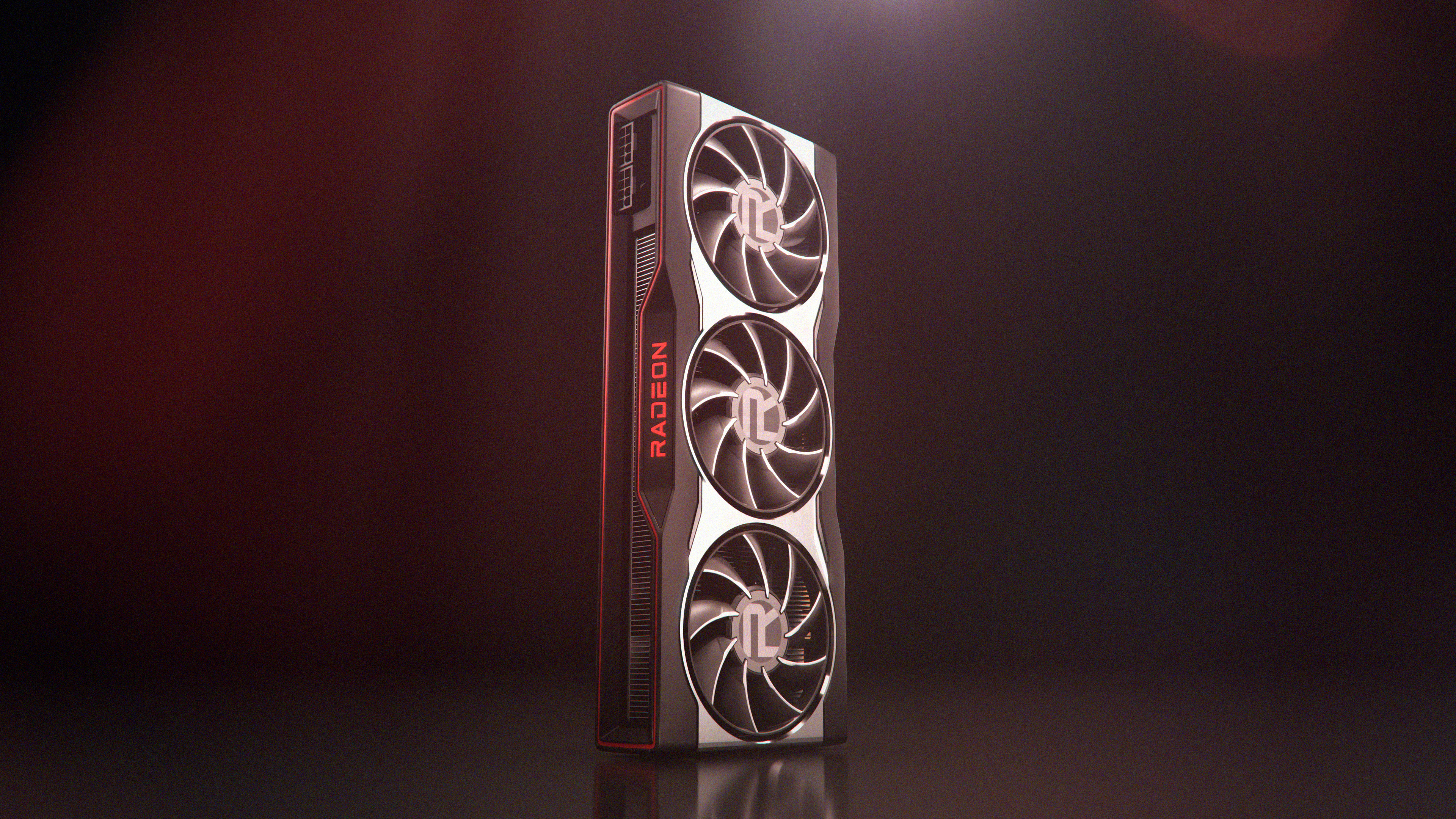 a product render of an AMD RX 6000 series graphics card standing on its end