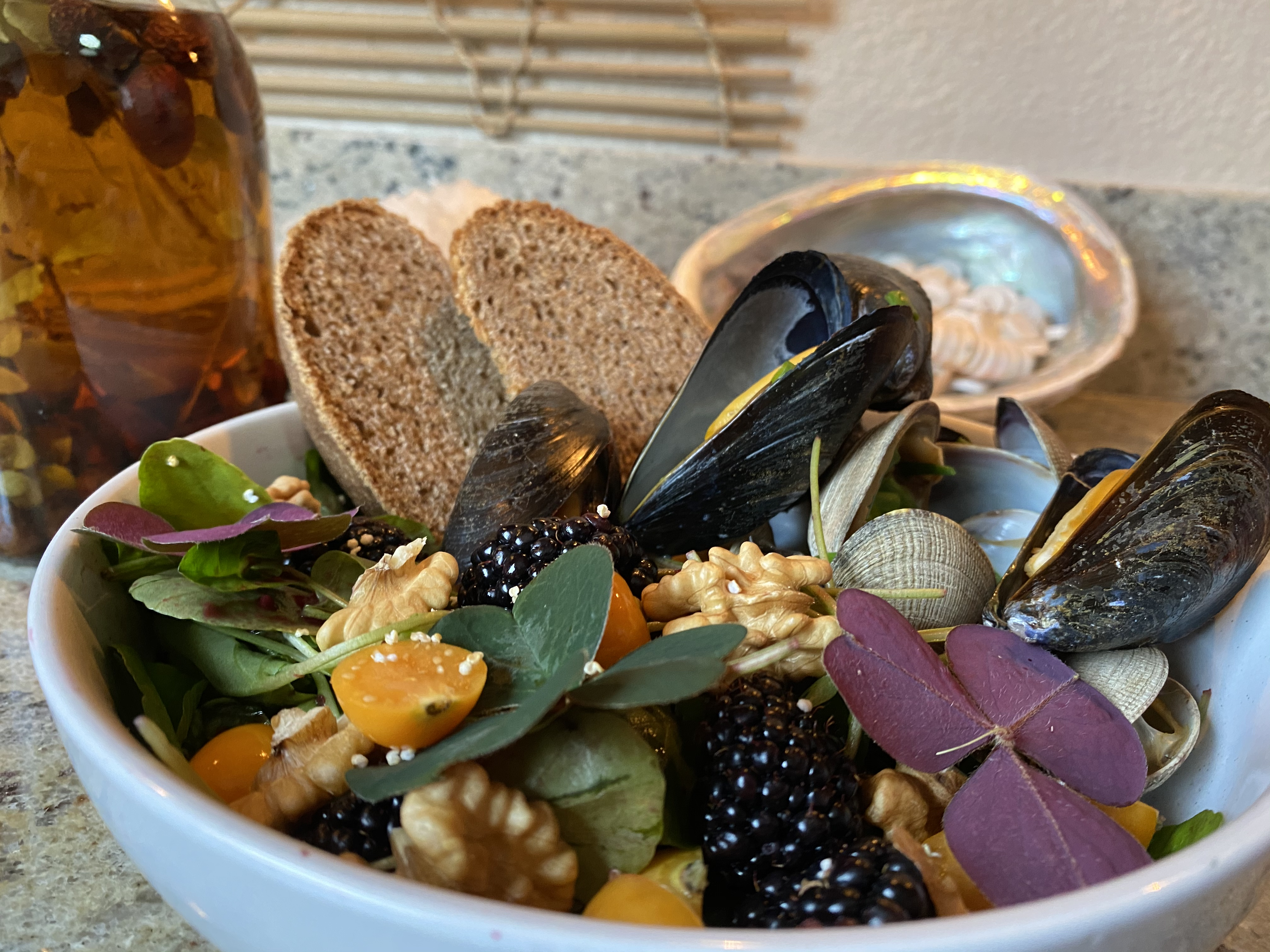An Ohlone clam and mussel dish, a version of which might be part of Cafe Ohlone's new takeout boxes