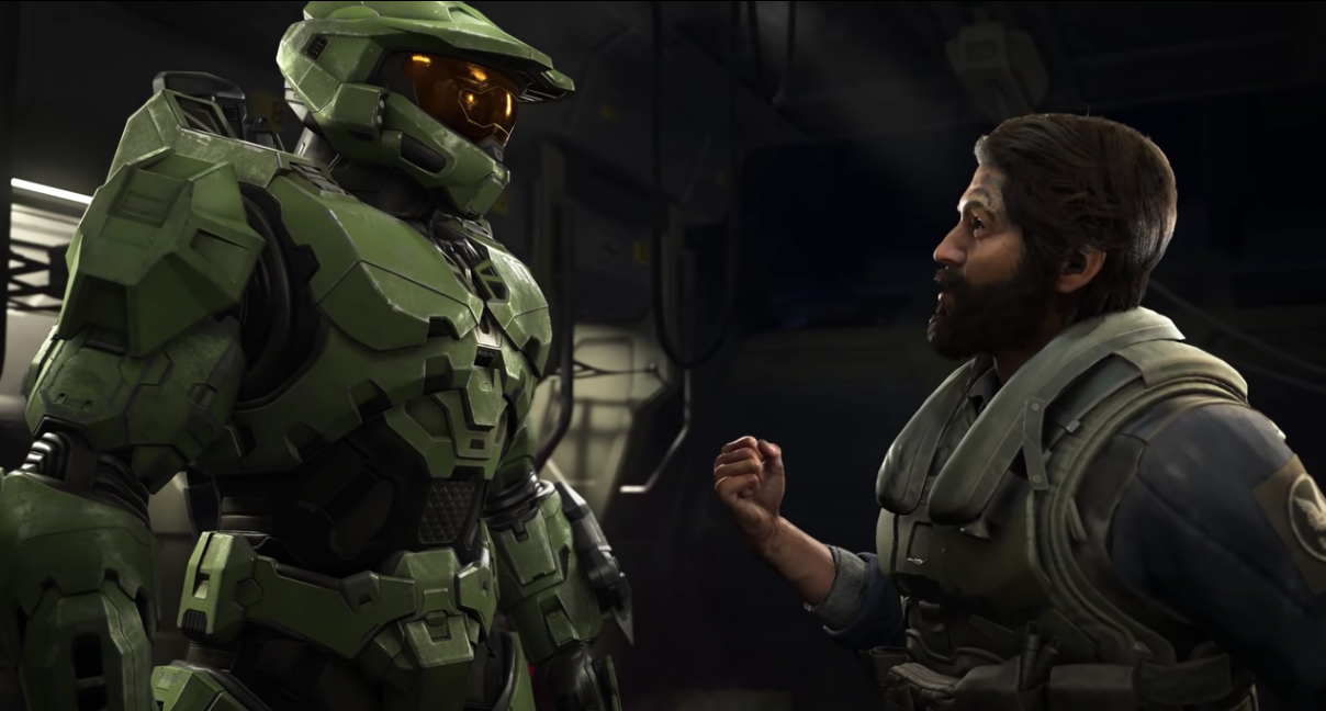 Master Chief and a non-armored NPC talking in the cargo bay of some kind of ship