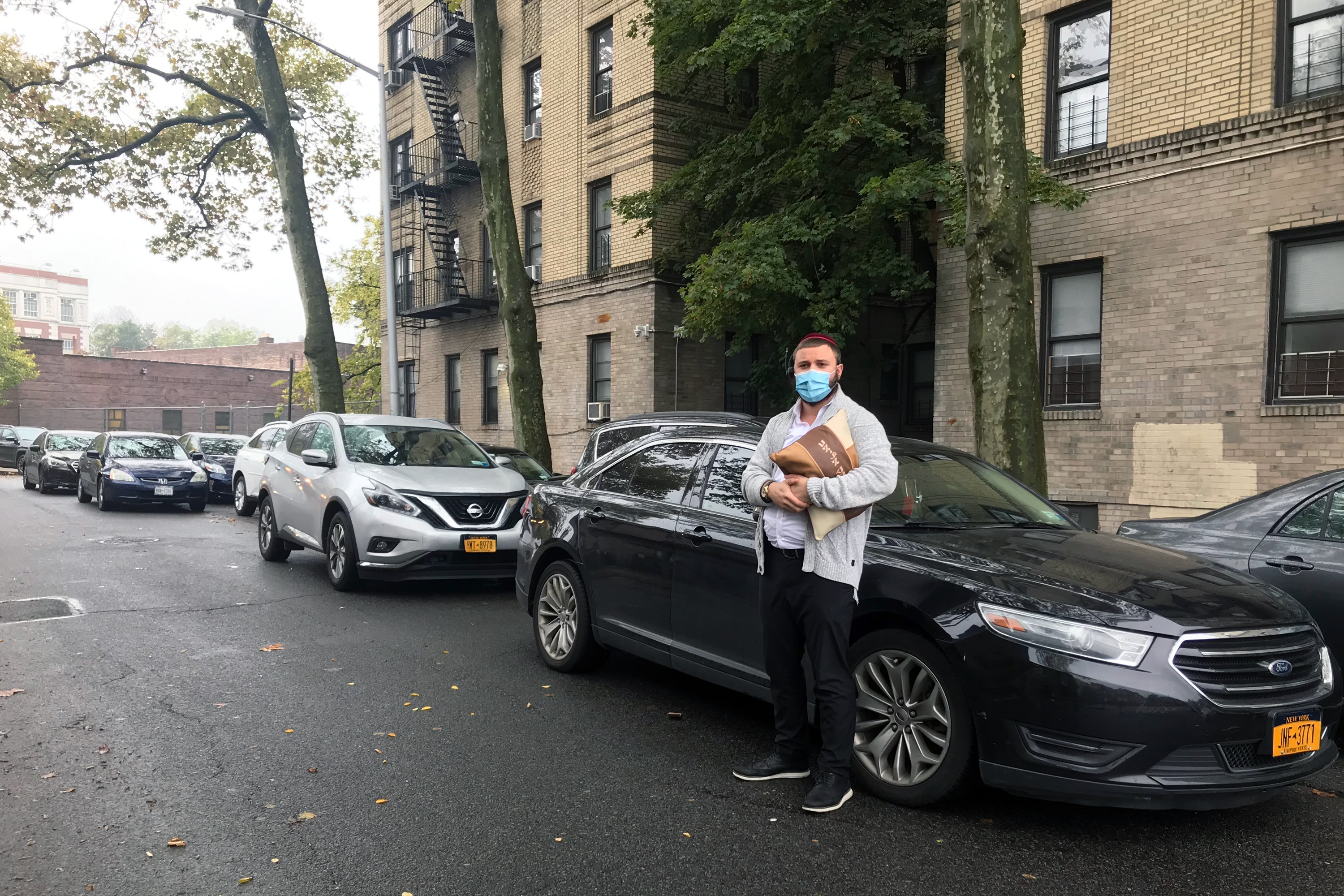 Yossi Eliav, 22, moved his car because alternate side parking remains in effect inside the Red Zone in Kensington, Brooklyn, Oct. 28, 2020.